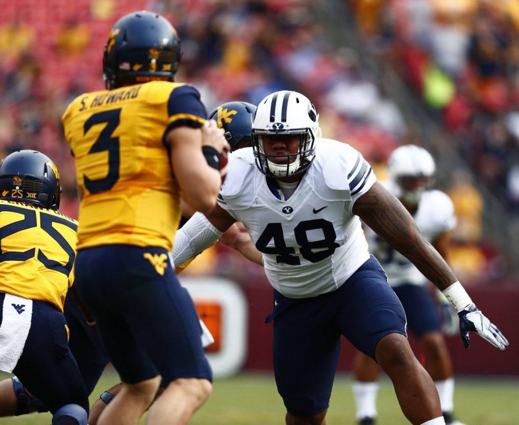 Moses Kaumatule (49) rushes the quarterback, BYU vs. West Virginia, Landover, Md., Sept. 24, 2016 | Photo by BYU