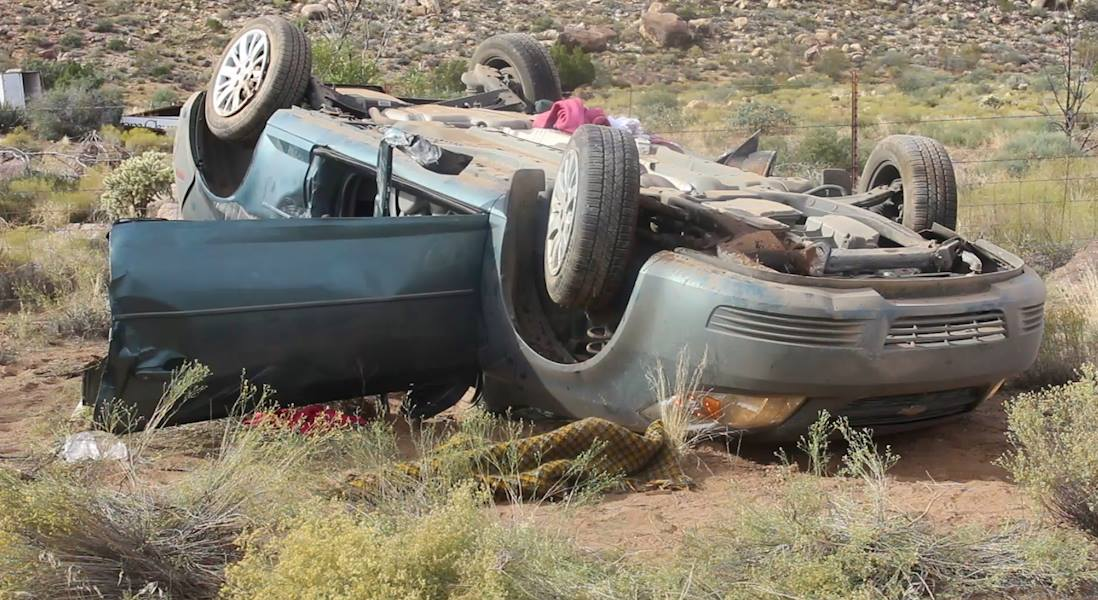 A car rests upside down after rolling over on Interstate 15, Utah, Oct. 14, 2016 | Photo by Mike Cole, St. George News