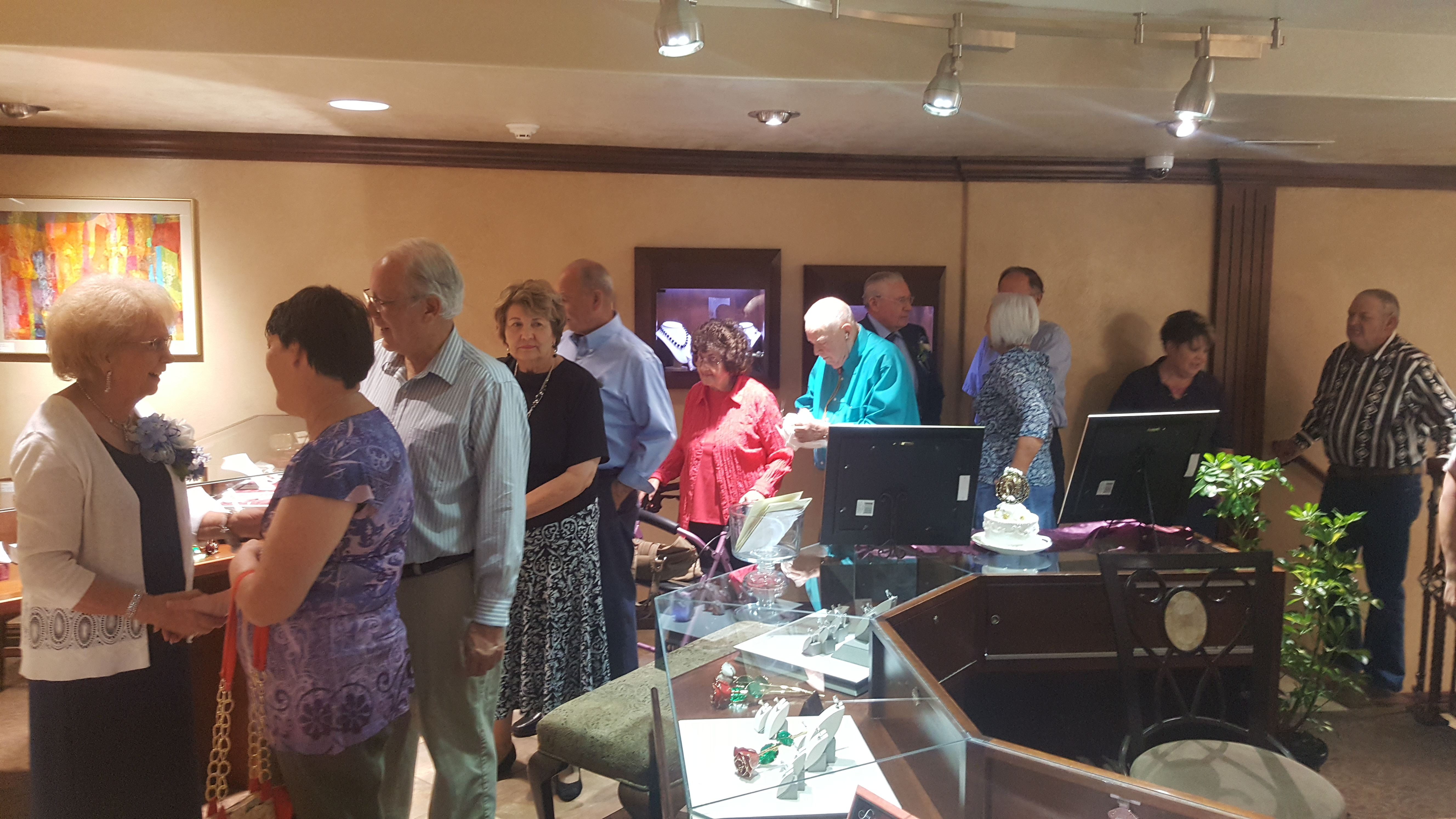 LaRee and Heber Jones greet guests at their 60th wedding anniversary, Forever Young Fine Jewelers, St. George, Utah, Oct. 12, 2016 | Photo courtesy of Megan Young, St. George News