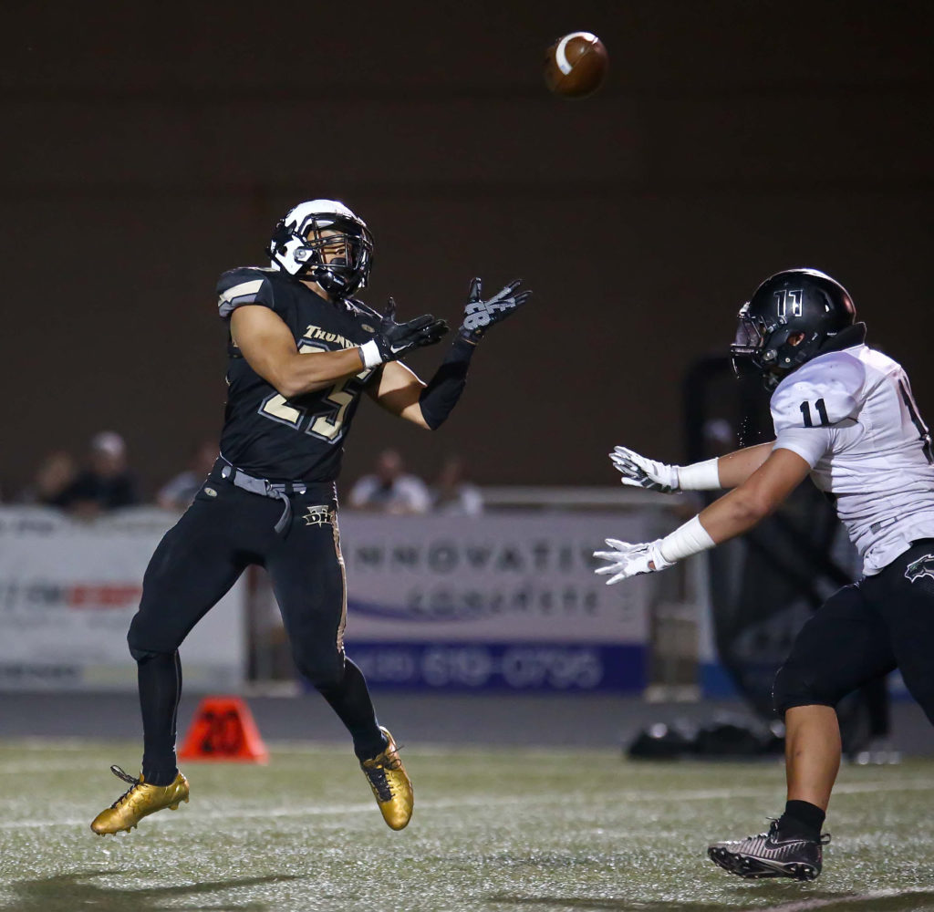 Desert Hills' Marco Jordan (25) makes a catch, Desert Hills vs. Pine View, Football, St. George, Utah, Oct. 7, 2016, | Photo by Robert Hoppie, ASPpix.com, St. George News