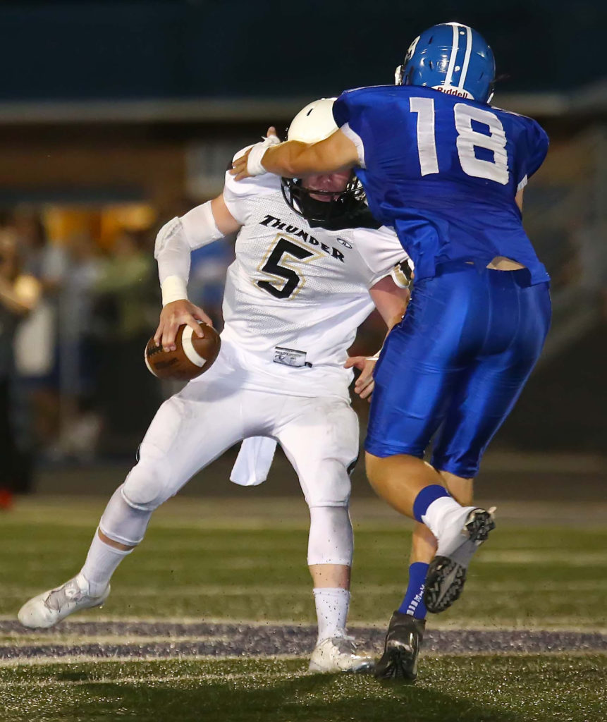 Dixie's Tyson Fisher (18) sacks Desert Hills quarterback Quinn Kiser (5), Dixie vs. Desert Hills, Football, St. George, Utah, Sept. 30, 2016, | Photo by Robert Hoppie, ASPpix.com, St. George News