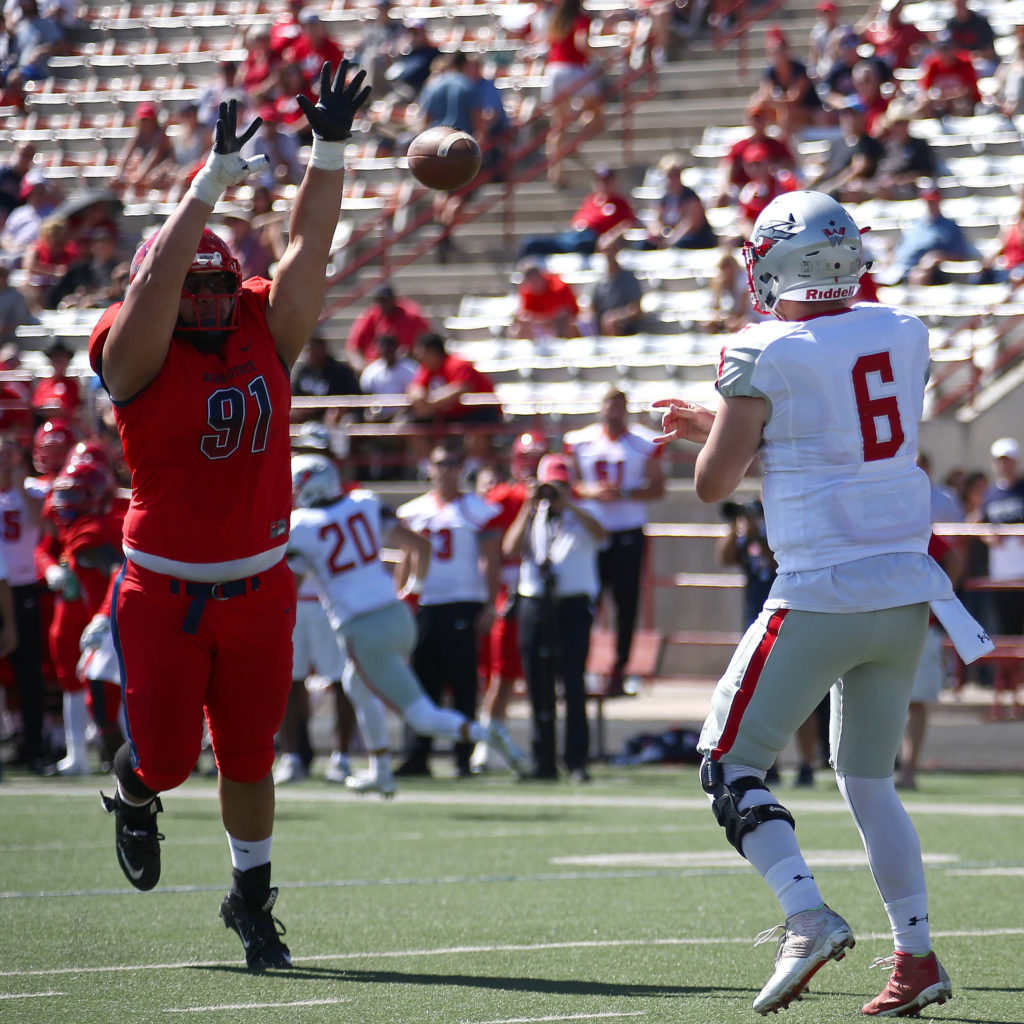 Dixie State's James Lautogia (91), Dixie State University vs. Western State Colorado University, Football , St. George, Utah, Oct. 1, 2016, | Photo by Robert Hoppie, ASPpix.com, St. George News