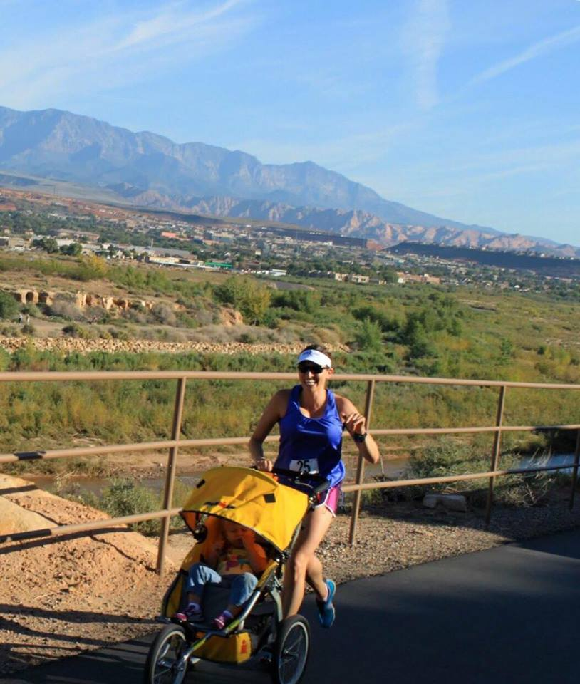 """A runner pushes a stroller during """"The Breast Run Ever"""" 5K, St. George, Utah, date not specified 