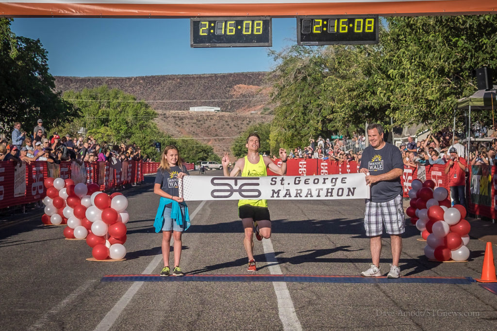 Riley Cook crosses the finish line to win the 2016 St. George Marathon Saturday morning, St. George, Utah, Oct. 1, 2016 | Photo by Dave Amodt, St. George News