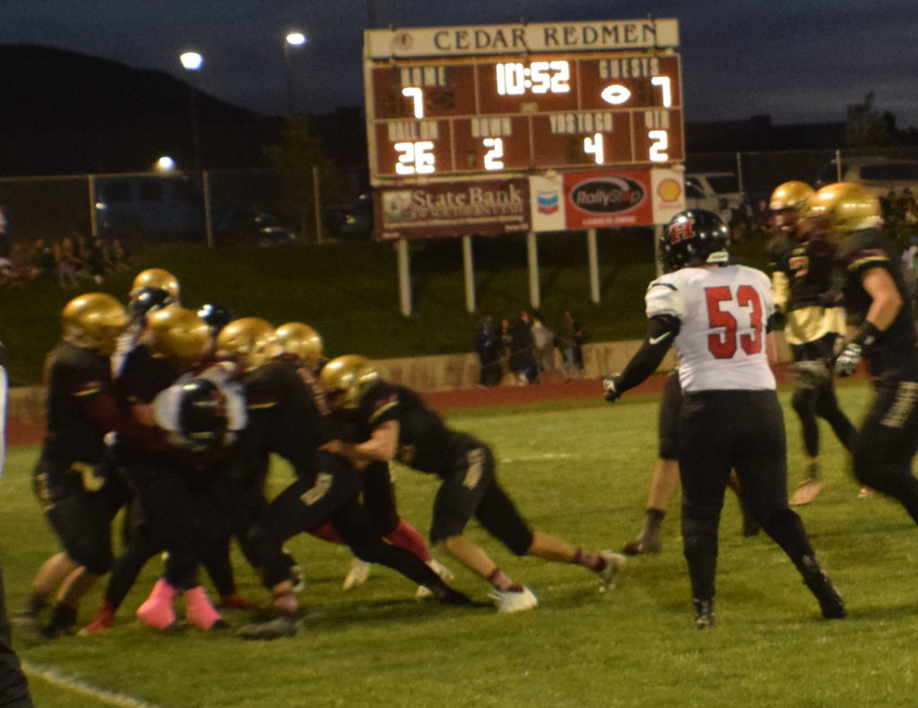 Joe Armijo makes some tough yards in the first half, Hurricane vs. Cedar, Cedar City, Utah, Oct. 7, 2016   Photo by Katina Young, for St. George News