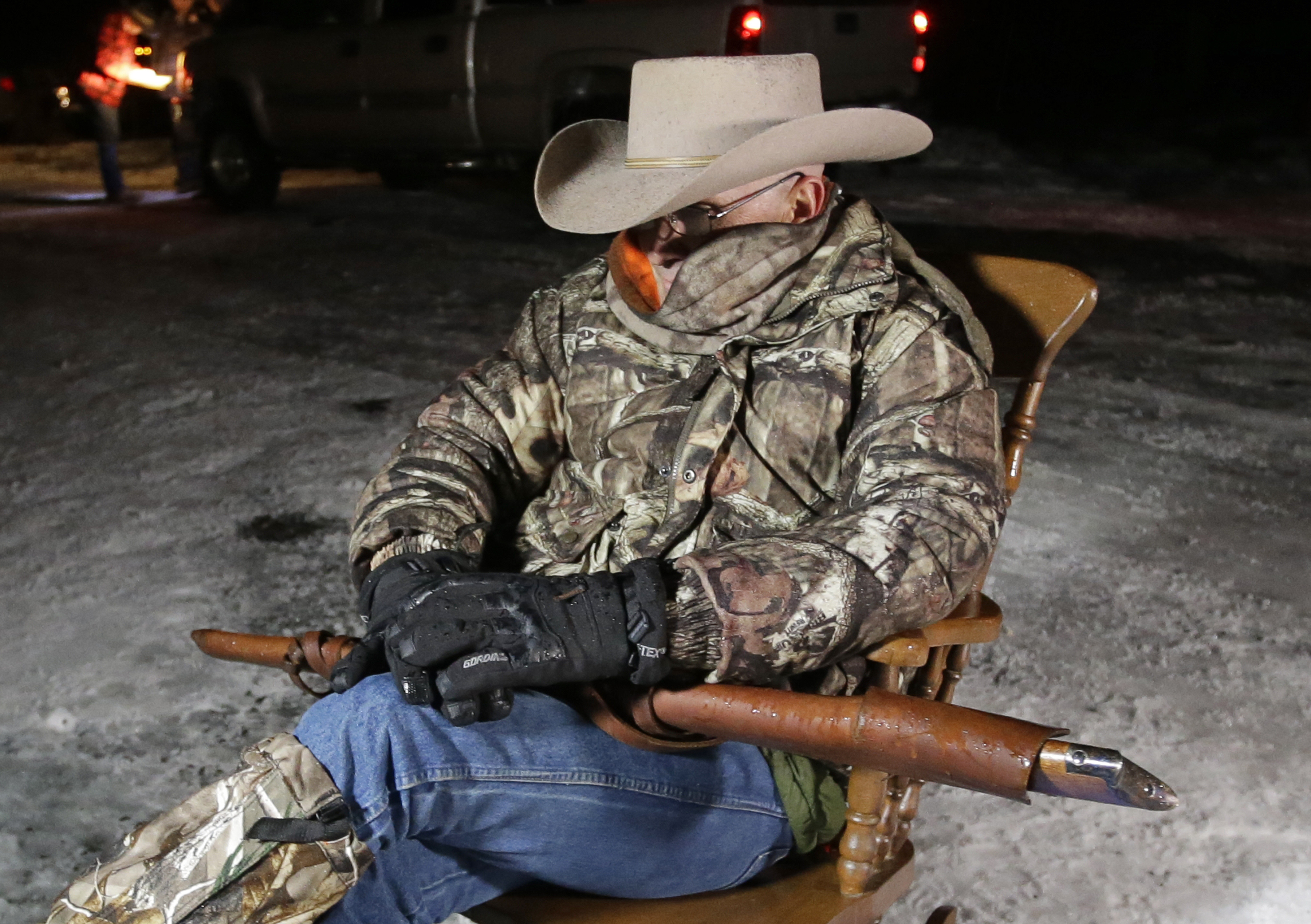 "In this Jan. 5, 2016, file photo, Arizona rancher Robert ""LaVoy"" Finicum, holds a rifle as he guards the Malheur National Wildlife Refuge near Burns, Ore. The stunning acquittal of seven people who occupied a federal bird refuge in Oregon as part of a Western land dispute was a rejection of the prosecution's conspiracy case, not an endorsement of the armed protest, a juror said Friday, Harney County, Oregon, Oct. 28, 2016 