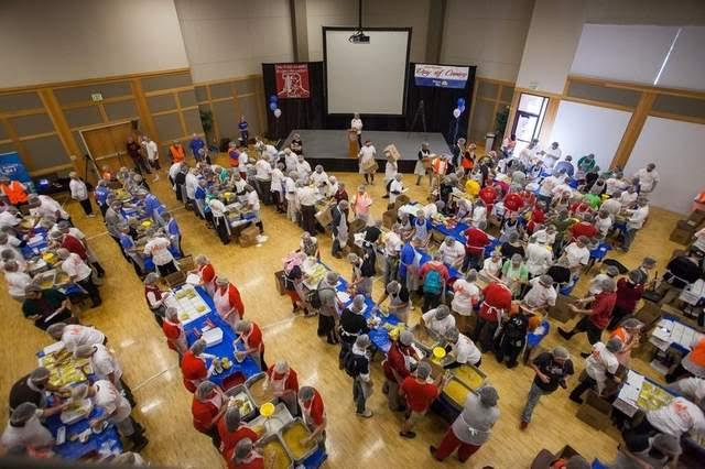 "In this photo from a previous United Way Dixie ""Day of Caring"" volunteers package meals to fight hunger in Washington County, St. George, Utah, date not specified 