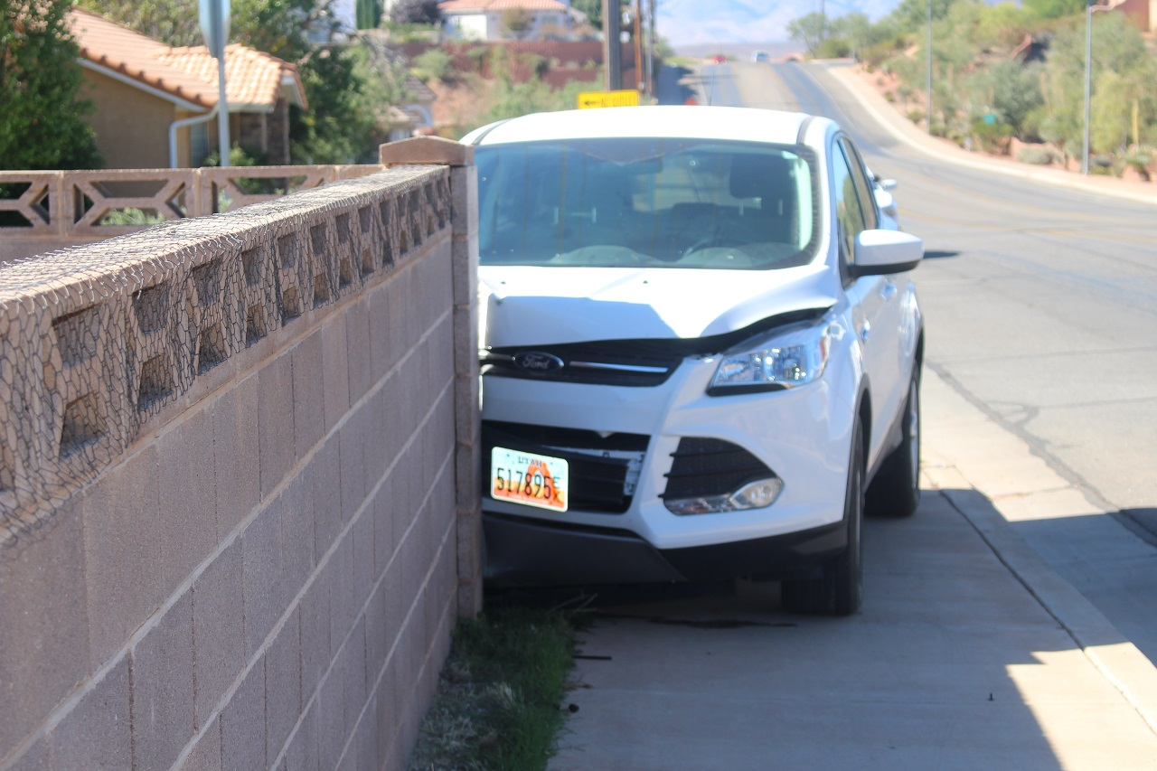 2016 Ford Escape crashed head on into a cinder block wall on 2000 North Thursday after the elderly driver possibly suffered from a medical issue, St. George, Utah Oct. 20, 2016 | Photo by Cody Blowers, St. George News
