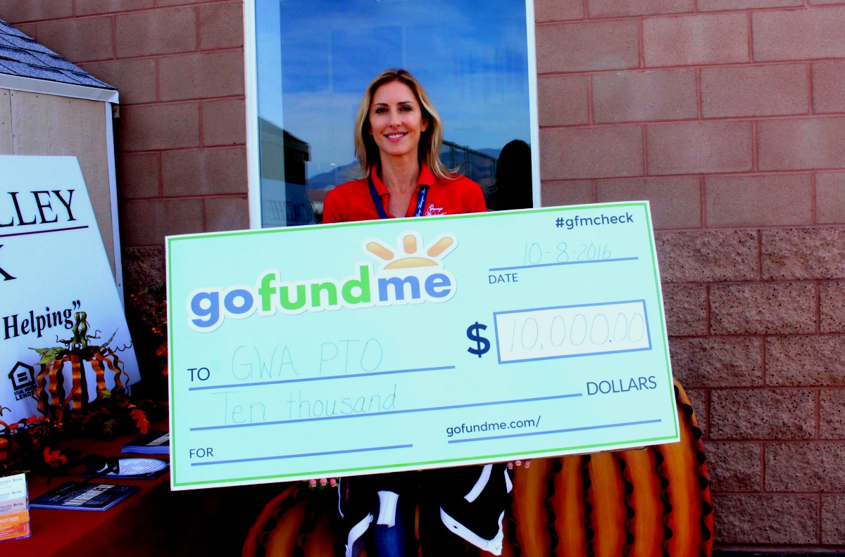 George Washington Academy's Executive Director Anya Yeager holds $10,000 check awarded to the school after taking first place in fundraising contest, George Washington Academy, St. George, Utah, Oct. 8, 2016 | Photo by Cody Blowers, St. George News