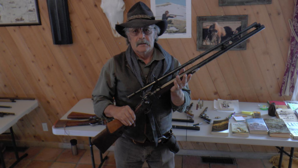 Firearms instructor and Silver Reef Museum guide showcases some of his private gun collection at the Old Cosmopolitan building in the Silver Reef area of Leeds, Utah, date not specified | Photo courtesy of the Silver Reef Foundation, St. George News