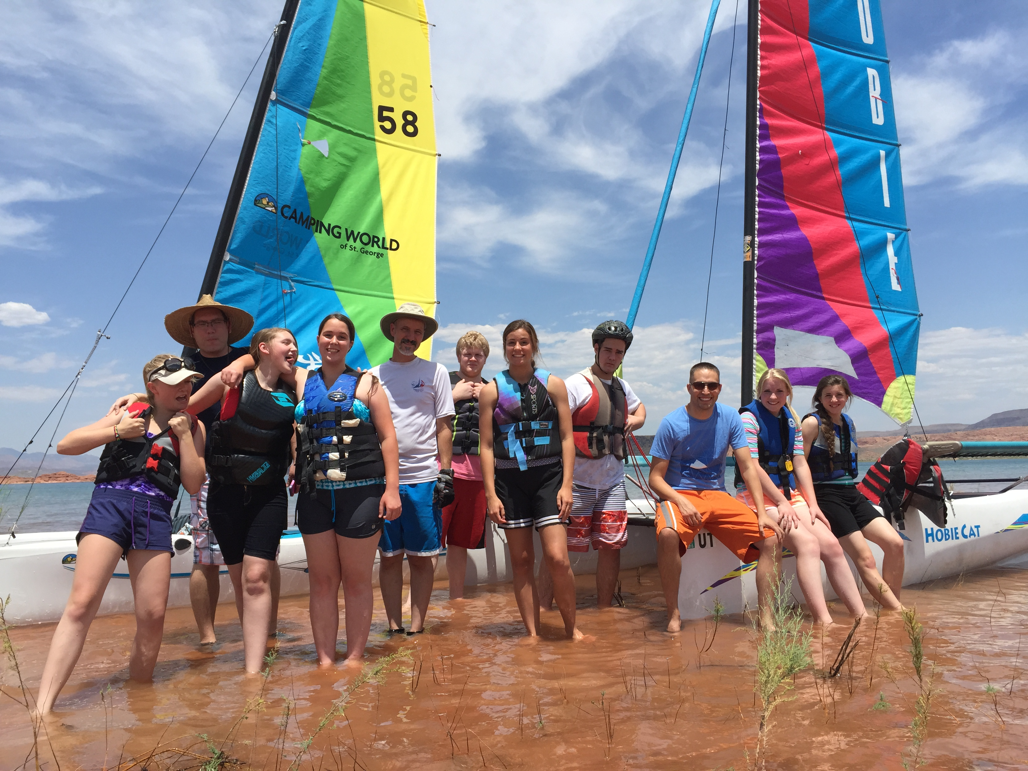 This 2015 photo shows youth posing by some sailboats during Raul Hevia's Youth Summer Sailing School at Sand Hollow Reservoir, Sand Hollow State Park, Hurricane, Utah, Summer 2015 | Photo courtesy of Raul Hevia, St. George News