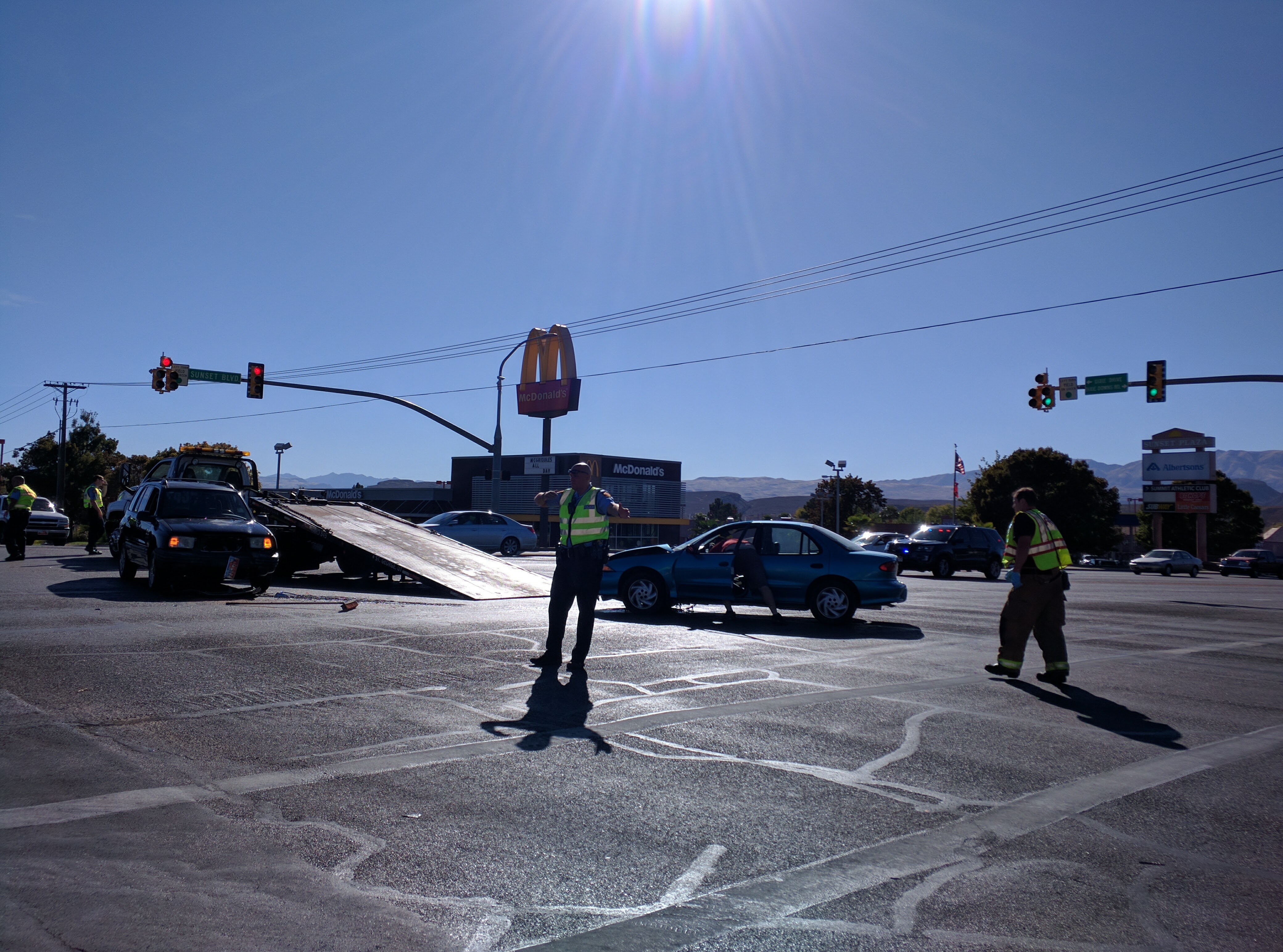 Emergency crews clean up after a collision on Sunset Boulevard, St. George, Utah, Oct 15, 2016 | Photo by Joseph Witham, St. George News