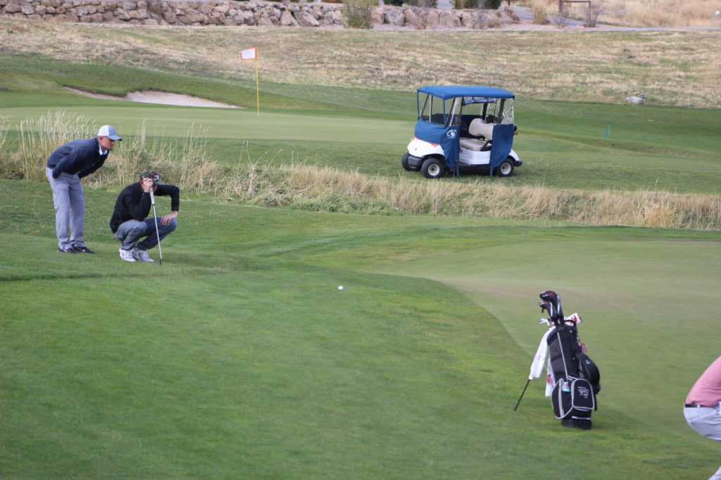Pine View's Noah Schone, with coach Brayden Bergeson, size up the final putt during the sudden death playoff hole at the 3A State Golf Tournament at Soldier Hollow Golf Course, Midway, Utah, Oct. 6, 2016   Photo by AJ Griffin, St. George News