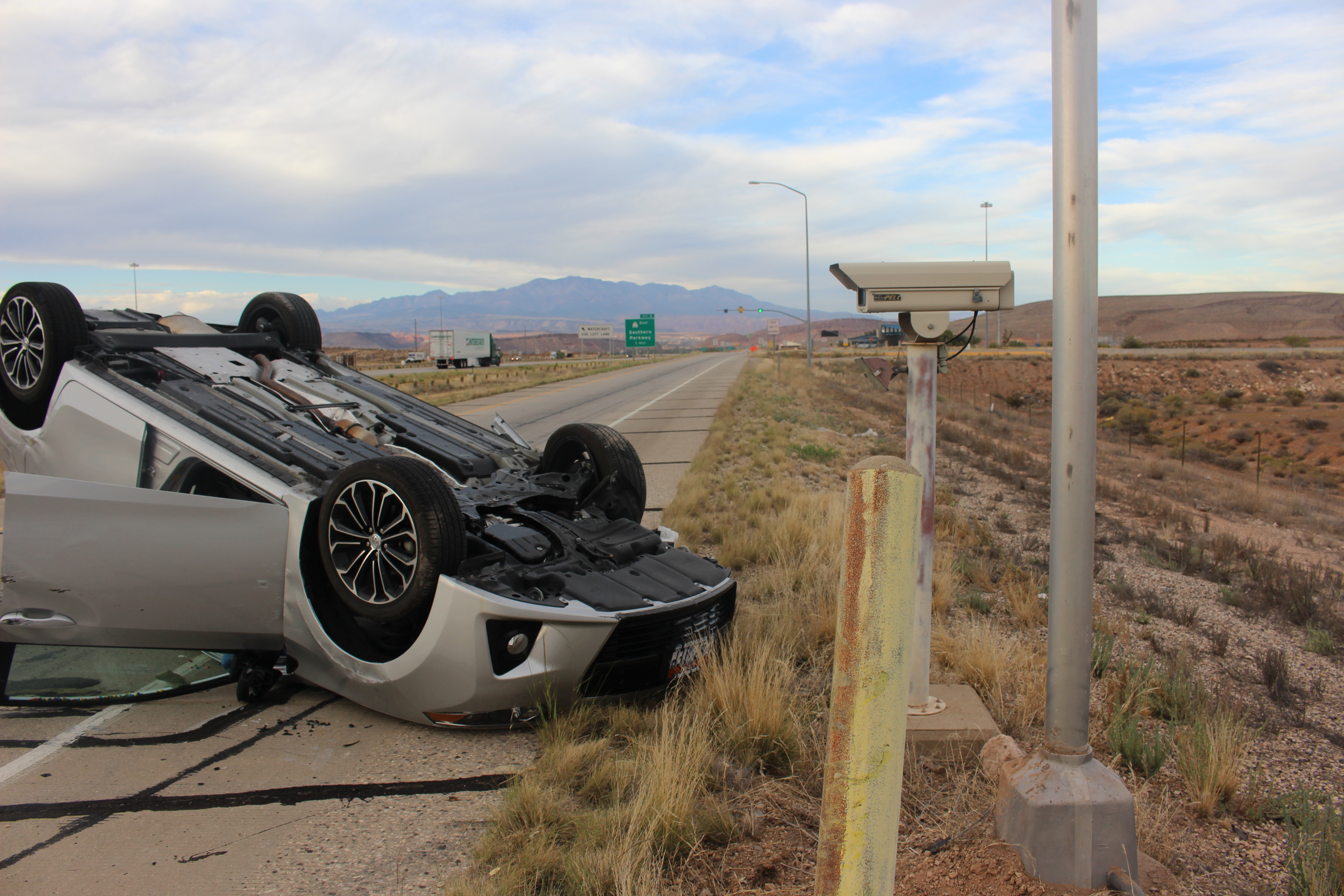 A car rests upside down after rolling over at the Utah-Arizona port of entry, Oct. 14, 2016 | Photo by Joseph Witham, St. George News