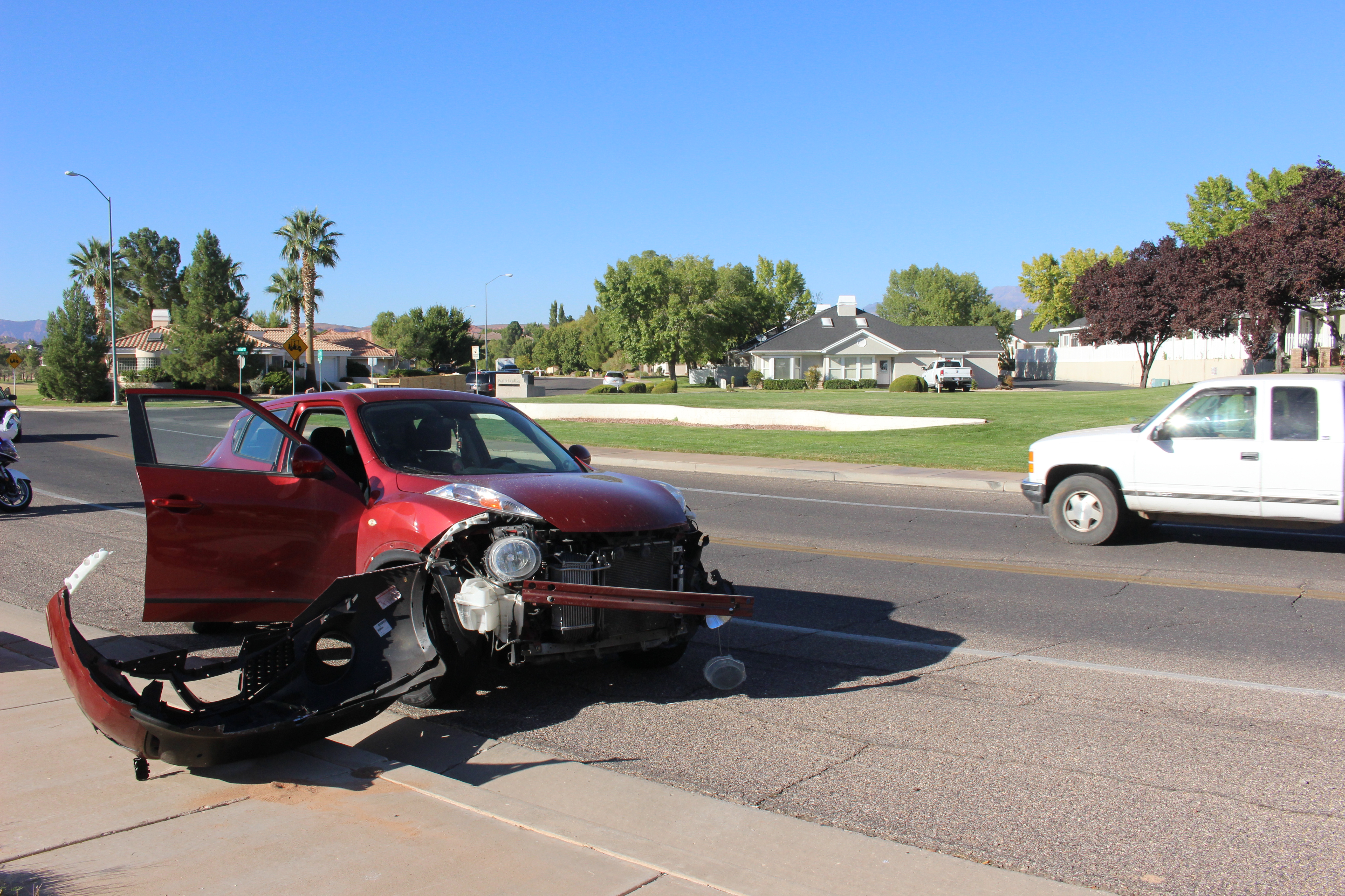 A car sustains heavy damage after a collision on Fort Pierce Drive North, St. George, Utah, Oct. 21, 2016 | Photo by Joseph Witham, St. George News