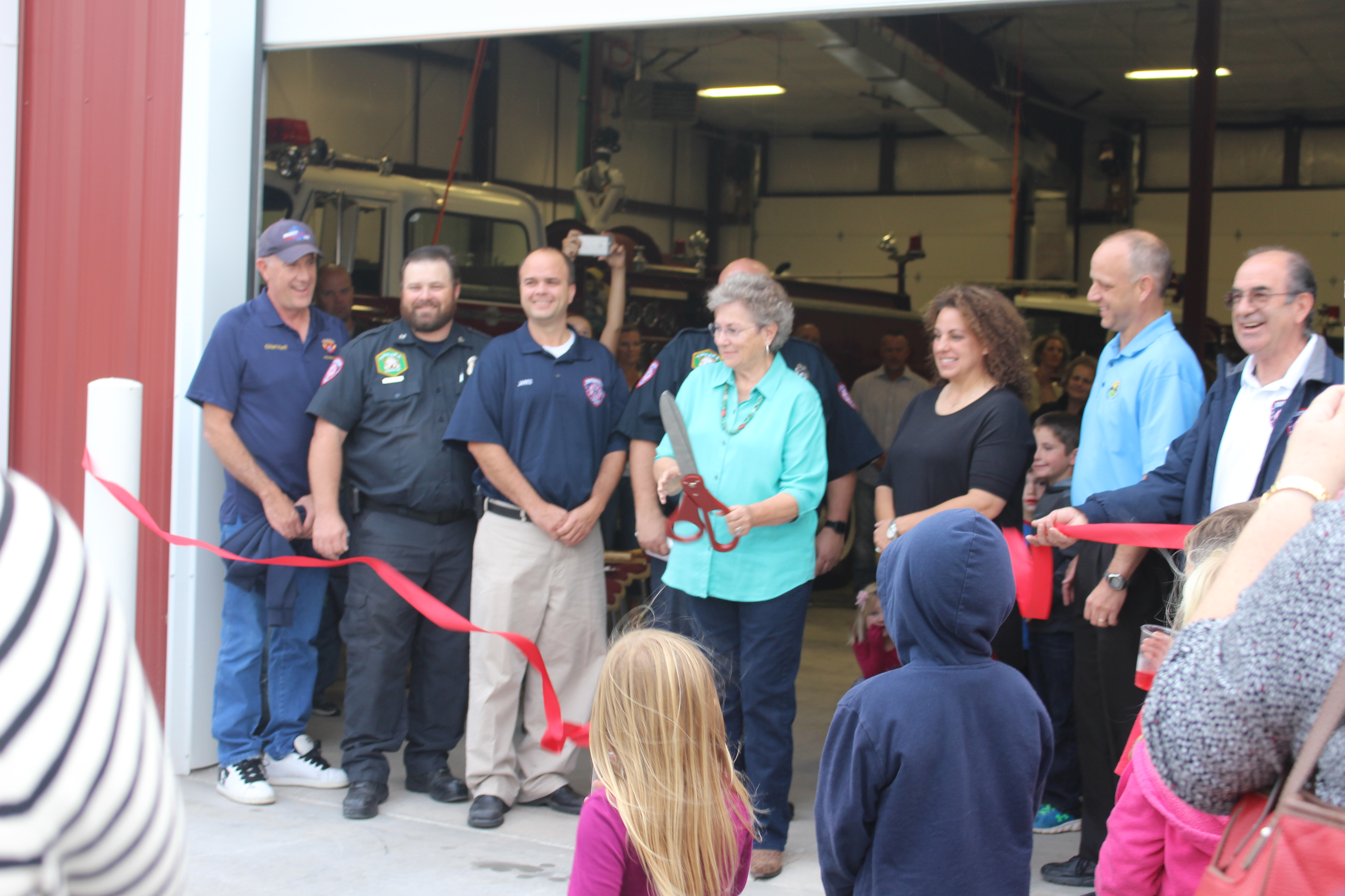 Elizabeth Bryson performs the ribbon-cutting at the newly opened Lynn K. Bryson Fire Station, Enterprise, Utah, Oct. 28, 2016 | Photo by Joseph Witham, St. George News