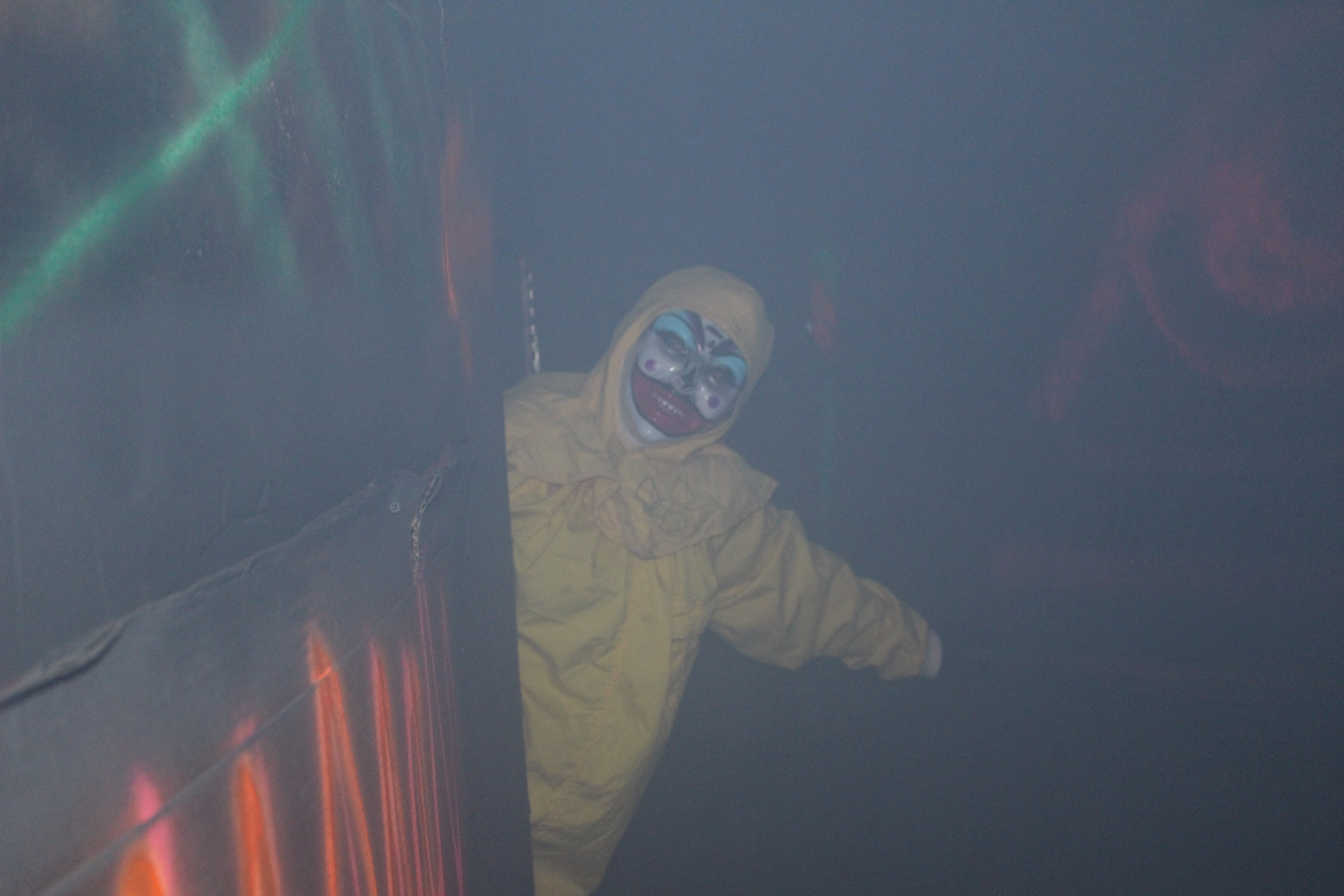 A creepy clown spooks guests at a haunted house promoting awareness for dysautonomia, St. George, Utah, Oct. 29, 2016 | Photo by Joseph Witham, St. George News