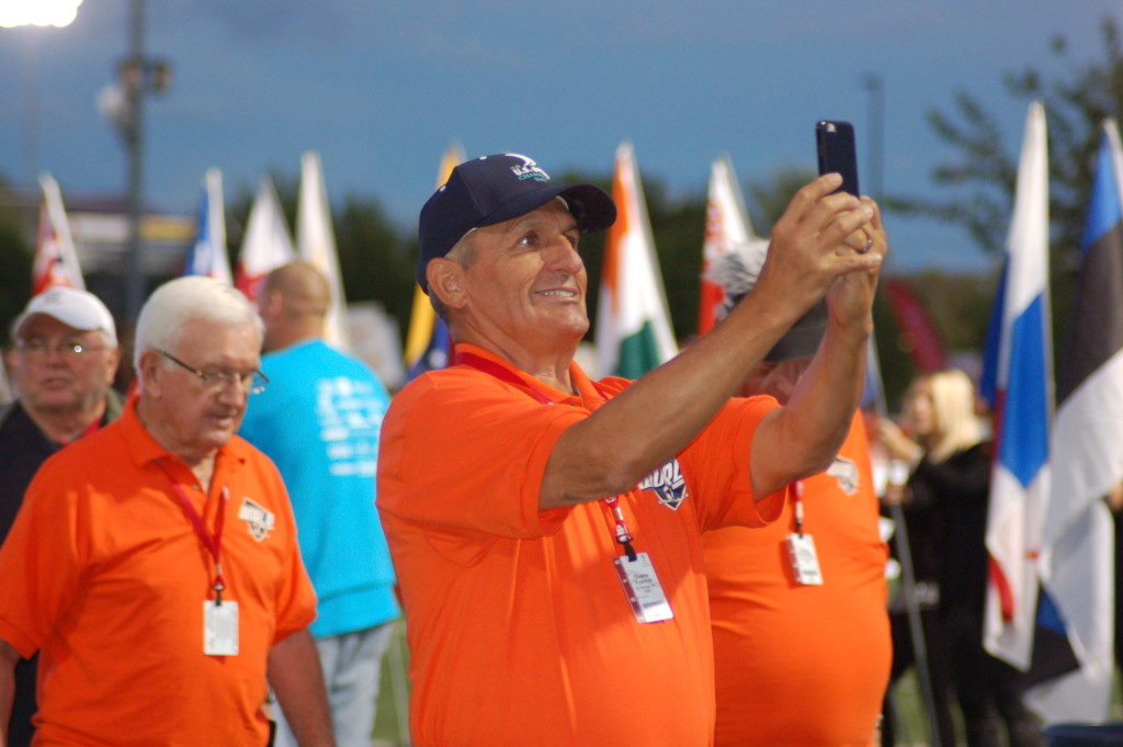 In this photo from October 2015, a Senior Games athlete takes a selfie during the opening ceremonies of the games, St. George, Utah, Oct. 6, 2015 | Photo by Hollie Reina, St. George News