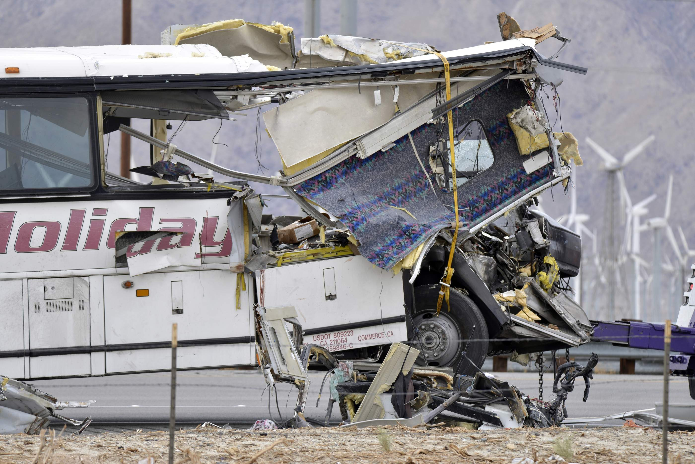 The damaged front of a tour bus is seen that crashed into the back of a semi-truck on Interstate 10 just north of the desert resort town of Palm Springs, in Desert Hot Springs, Calif., Sunday, Oct. 23, 2016. Several deaths and injuries were reported. | AP Photo/Rodrigo Pena, St. George News