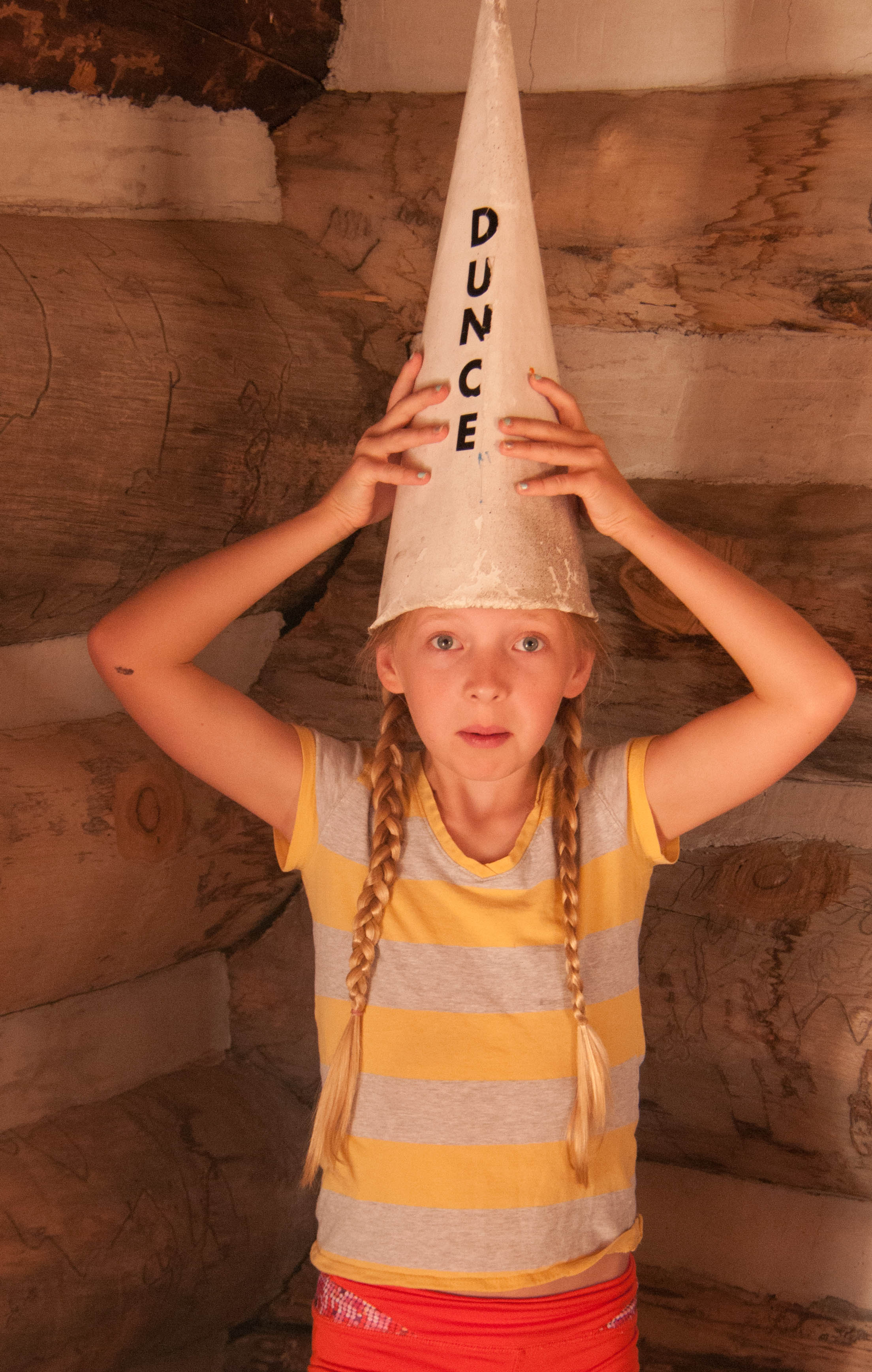 Visitor Lillie Brown acts the part of a dunce, Frontier Homestead State Park Museum, Cedar City, Utah, August 2016 | Photo by Jim Lillywhite, St. George News