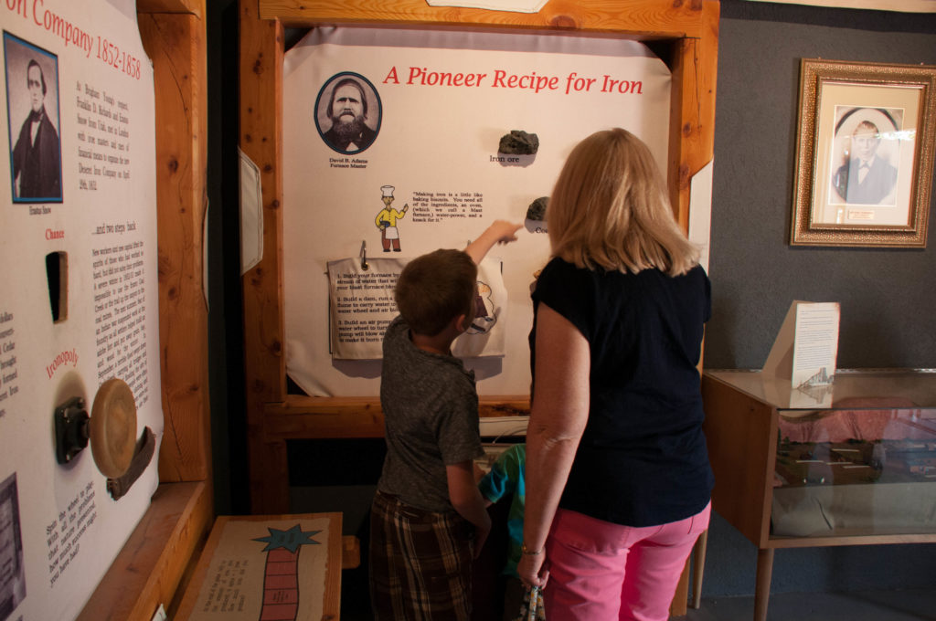 Visitors observe the recipe for making iron, Frontier Homestead State Park Museum, Cedar City, Utah, August 2016 | Photo by Kathy Lillywhite, St. George News
