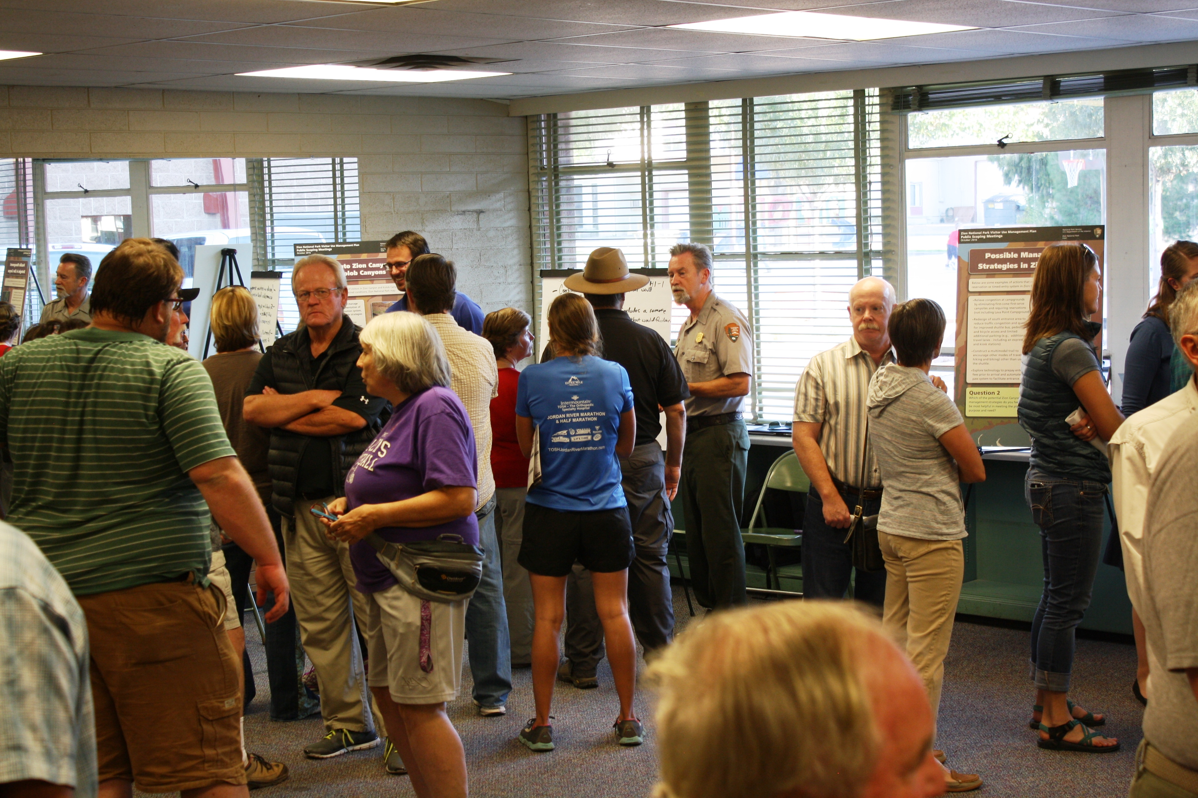 Attendees at a public scoping session for the Zion Visitor Use Management Plan interact with park rangers and provide their input, Hurricane Community Center, Hurricane, Utah, Oct. 25, 2016 | Photo by Reuben Wadsworth, St. George News
