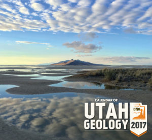 Evening skies are reflected in Great Salt Lake south of Antelope Island. Otherworldly scenes of wide mudflats are exposed as lake level nears record low elevation. Cover, Utah Geological Survey's 2017 Calendar of Utah Geology | Photo by Andy Cvar, St. George News