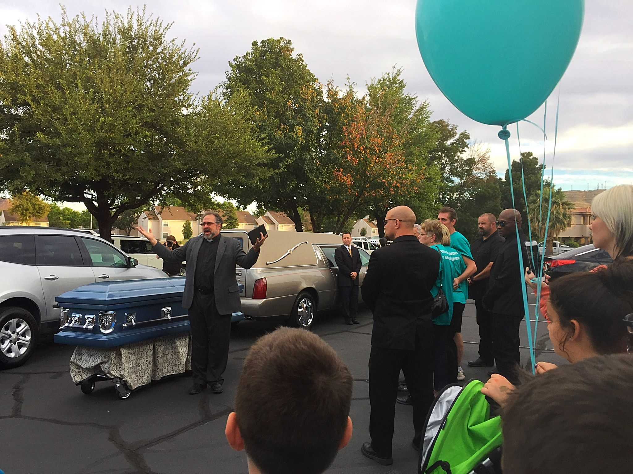"David Heisler arrived ""home"" to Utah in a prepossessing blue casket to a crowd gathered to welcome him home and honor his memory by releasing 110 teal helium balloons – one for every day he was gone, St. George, Utah, Oct. 14, 2016 