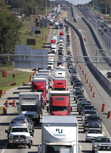 Traffic stacks up on I-75 North fleeing the coast and Hurricane Matthew on Thursday, Oct. 6, 2016, near McDonough, Ga. Hurricane Matthew steamed toward heavily populated Florida with terrifying winds of 140 mph Thursday, and 2 million people across the Southeast were warned to flee inland. (Curtis Compton/Atlanta Journal-Constitution via AP)