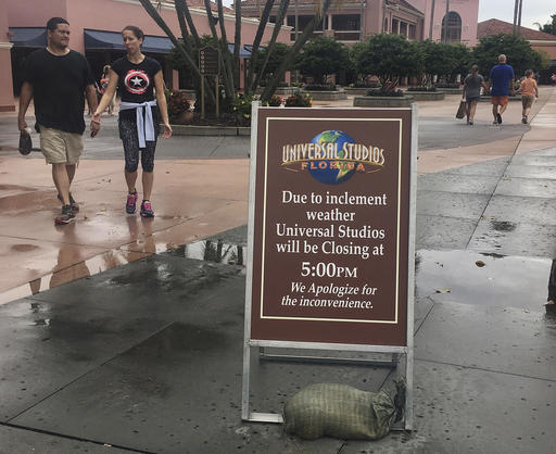 Park guests depart from Universal Studios, Thursday, Oct. 6, 2016, in Orlando, Fla. Leaving more than 100 dead in its wake across the Caribbean, Hurricane Matthew steamed toward heavily populated Florida with terrifying winds of 140 mph Thursday, and 2 million people across the Southeast were warned to flee inland. In inland Orlando, Walt Disney World, Universal Studios and SeaWorld announced plans to close early Thursday, Oct. 6, 2016   AP Photo by Janelle Cogan, St. George News