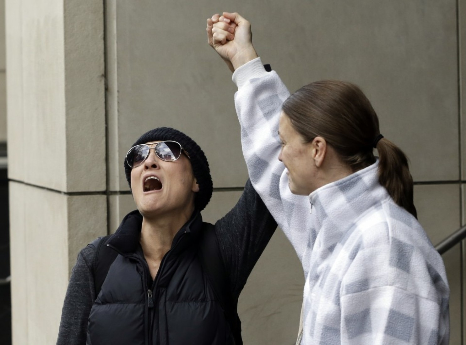 Supporters celebrate after hearing a verdict outside federal court. A jury exonerated brothers Ammon and Ryan Bundy and five others of conspiring to impede federal workers from their jobs at the Malheur National Wildlife Refuge. Portland, Oregon, Oct. 27, 2016 | Photo by Don Ryan (AP), St. George News