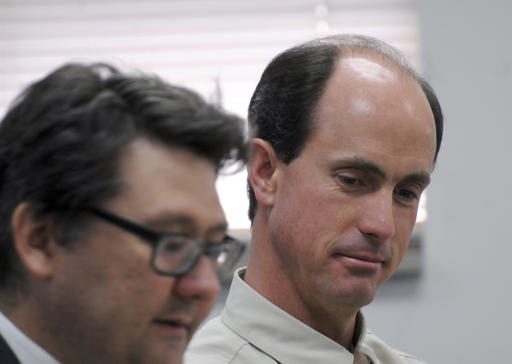 FILE - Seth Jeffs, right, brother of imprisoned polygamous sect leader Warren Jeffs, participates in a state water board meeting in Pierre, S.D. Polygamous sect leader Jeffs, charged with fraud, told a judge in Salt Lake City, Tuesday, Oct. 4, 2016, that not sharing goods purchased with food stamps would prohibit him and others from living their religion and being prepared for heaven. Salt Lake City, Utah, July 9, 2015 | Photo by AP Photo/James Nord, File, St. George News