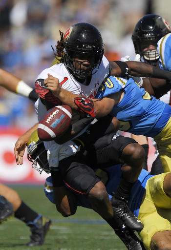 Utah punt returner Boobie Hobbs, left, fumbles the ball as UCLA long snapper Johnny Den Bleyker hit him during a punt return in the first half of an NCAA college football game, Saturday, Oct. 22, 2016, in Pasadena, Calif. Utah recovered the ball. (AP Photo/Mark J. Terrill)