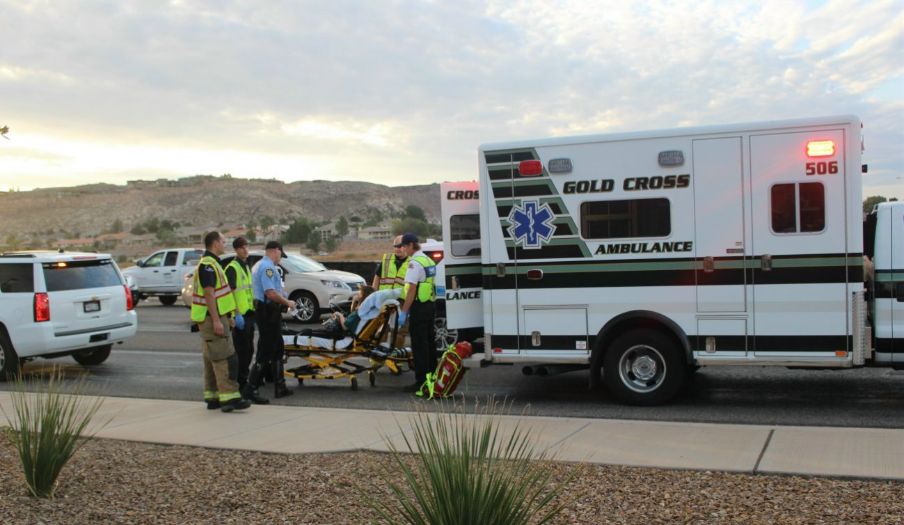 A woman driving a passenger car involved in a three-car collision at the intersection of River Road and 1450 South was taken to the hospital for examination of possible injuries, St. George, Utah, Oct. 24, 2016 | Photo by Mori Kessler, St. George News