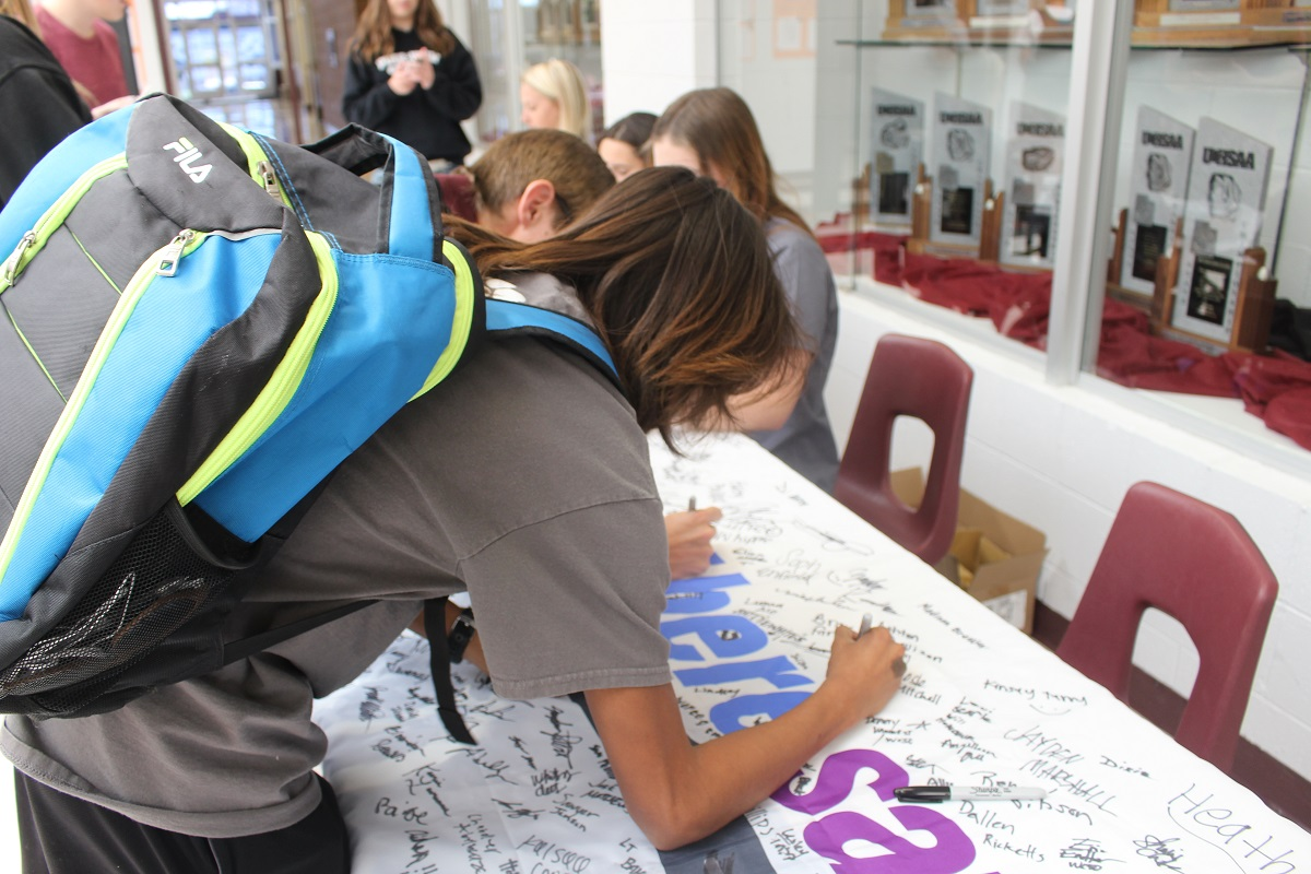 Students sign flag and pledge to participate in Allstate Foundation's #GetThereSafe program that launched at Pine View High School Friday, St. George, Utah, Oct. 21, 2016 | Photo by Cody Blowers, St. George News