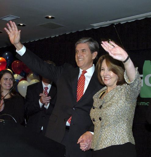 FILE - In this file photo, Sen. Gordon Smith, R-Ore., with his wife Sharon, waves to supporters after announcing that his race against Jeff Merkely is to close to call in Portland, Ore. In leaked videos, Mormon leaders discussed concerns about the growth of the gay rights movement and heard from former U.S. senator and church member Smith, who tells them the Iraq war could open the door for new converts, according to footage that pulls back the curtain on a religion that is closely guarded about its inner workings. The 15 videos were posted online Sunday, Oct. 2, 2016, during the final day of the religion's twice-yearly conference. Portland, Oregon, November 4, 2008 | Photo by AP Photo/Steve Slocum, File, St. George News