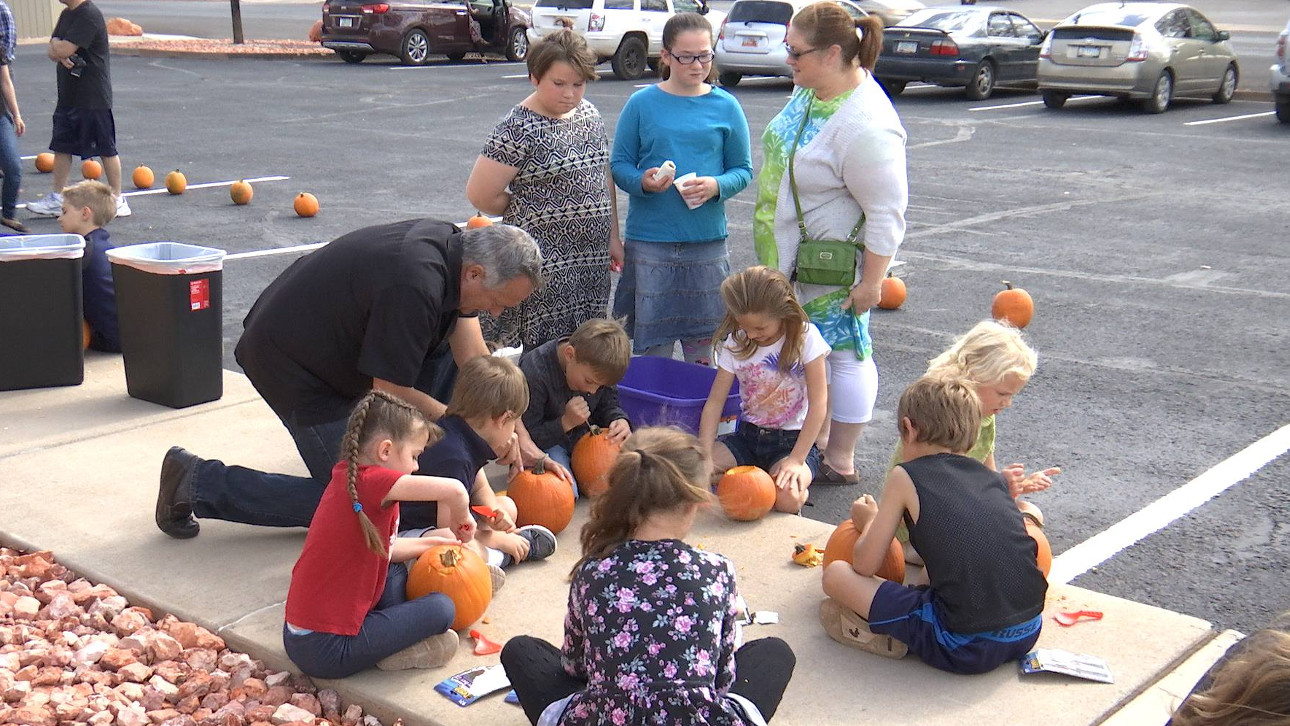 Scott P. Taylor, D.D.S, helps kids with during a pumpkin carving contest at the newly opened Hildale Dental, Hildale, Utah, Oct. 29, 2016 | Photo by Sheldon Demke, St. George News