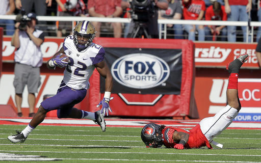 Washington running back Lavon Coleman (22) breaks free from Utah defensive back Jordan Fogal (13) in the first half during an NCAA college football game Saturday, Oct. 29, 2016, in Salt Lake City. (AP Photo/Rick Bowmer)