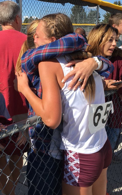 Pine View's Rylee Holt hugs a family member after setting a new Panther school record in girls cross country. | Photo courtesy @pvxctrack