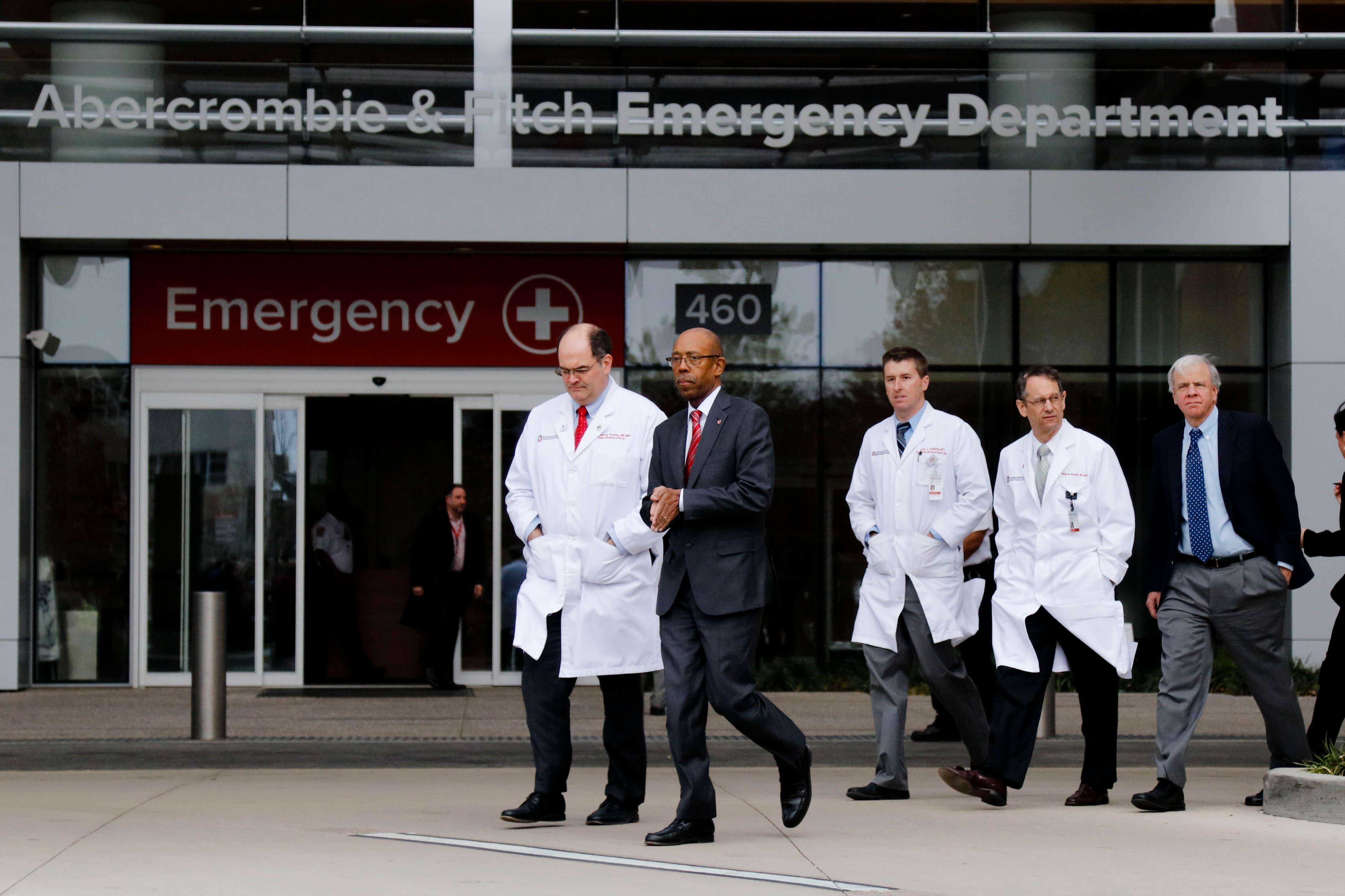 Ohio State University president Michael Drake, second from left, and Dr. Andrew Thomas, chief medical officer at the Wexner Medical Center, walk toward a press briefing following an attack on campus on Monday, Nov. 28, 2016 outside the Ohio State University Wexner Medical Center in Columbus, Ohio. Nine people were hospitalized after a man ran into pedestrians with his car then exited his vehicle and began cutting victims with a butcher knife. | Joshua A. Bickel/The Columbus Dispatch) /The Columbus Dispatch via AP, St. George News