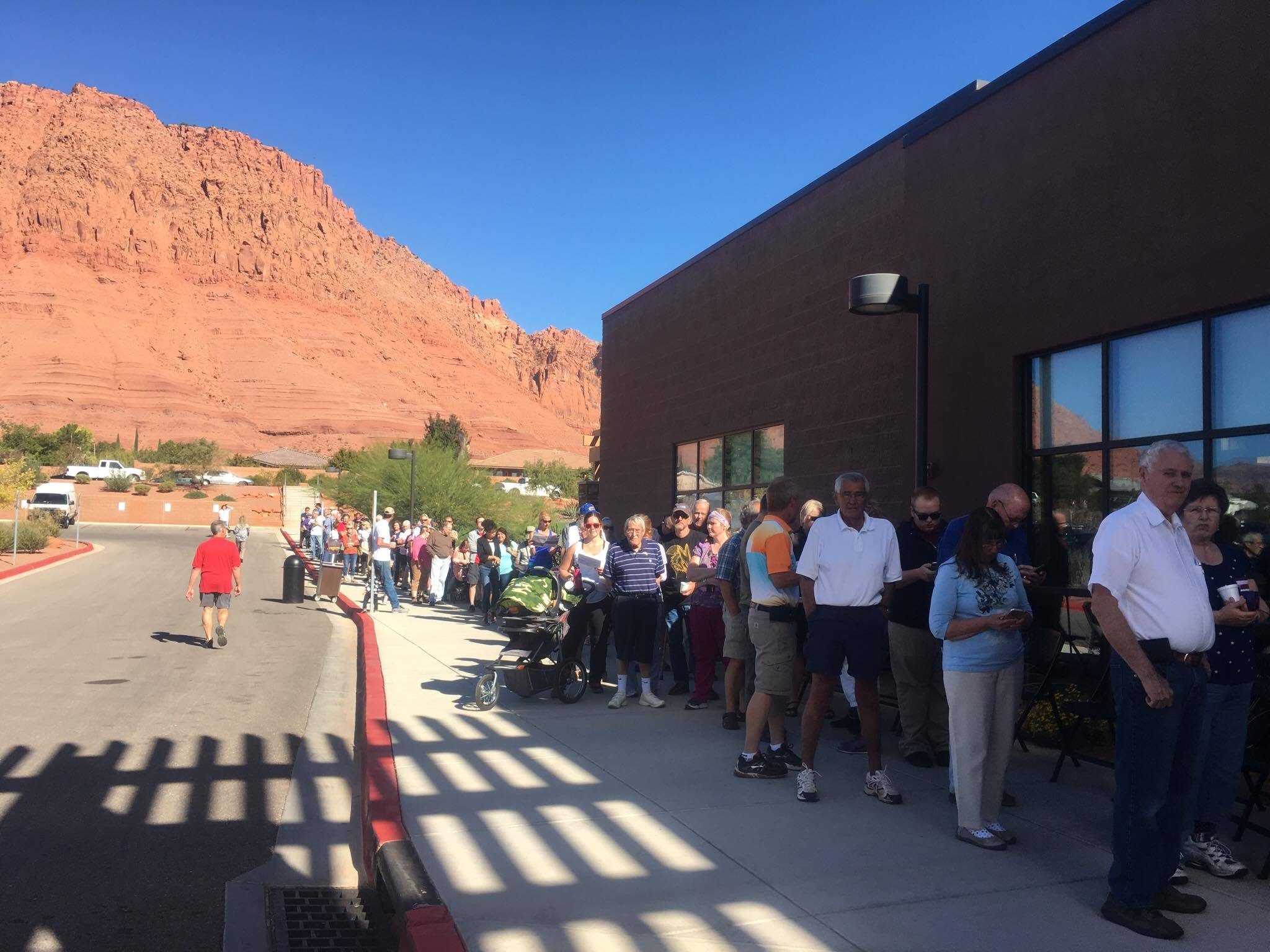 Lines of voters are long at the Southern Utah Veterans Home polling place in Ivins around 11:11 a.m. Tuesday. Electronic voting machines are still not functioning and voting is being done by paper ballots. Ivins, Utah, Nov. 8, 2016 | Photo by Hollie Reina, St. George News