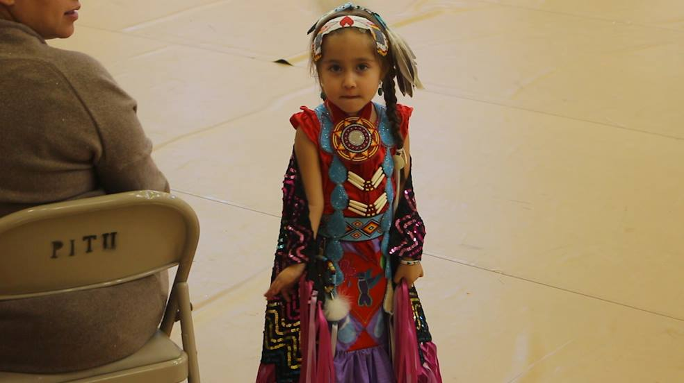 A girl in traditional regalia gets ready to dance in a Native American Heritage Month performance at the Paiute tribal headquarters in Cedar City, Utah, Nov. 10, 2016   Photo by Mike Cole, St. George News