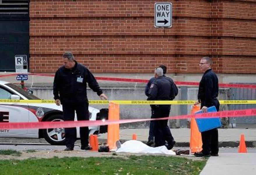 Police cover the body of a suspect outside Watts Hall on the campus of Ohio State University in Columbus, Ohio, following an attack on campus that left several people injured on Monday, Nov. 28, 2016. The man, identified as Abdul Razak Ali Artan, plowed his car into a group of pedestrians and began stabbing people with a butcher knife Monday before he was shot to death by a police officer. | Adam Cairns/The Columbus Dispatch via AP, St. George News