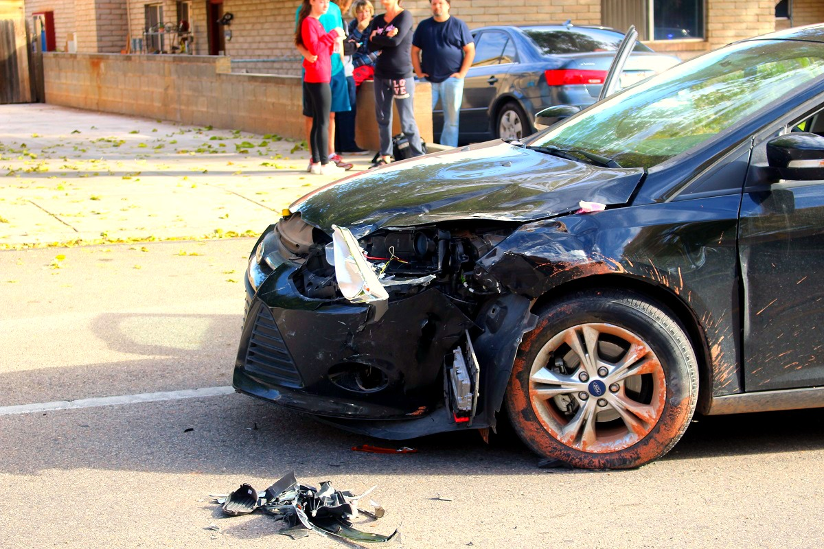 A black Ford Focus is prepared to be towed after a two-car crash on South 400 East, St. George, Utah, Nov. 26, 2016 | Photo by Cody Blowers, St. George News