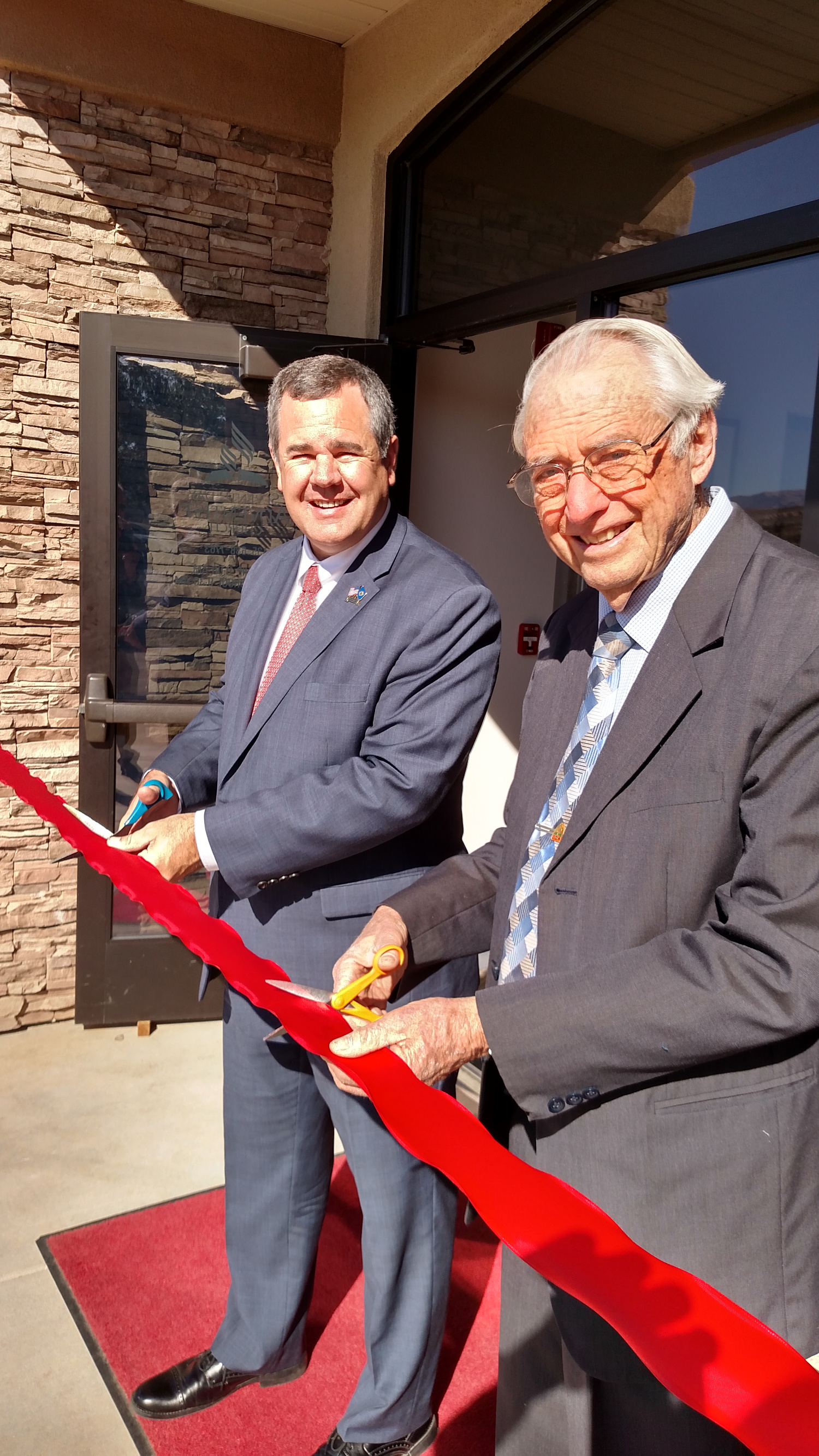 St. George Mayor Jon Pike and Pastor Dan Walter cut the ribbon in celebration of the Red Cliffs Seventh-day Adventist Church facility, located at 1165 W. Silicon Circle in St. George, Utah, Nov. 8, 2016 | Photo courtesy of Robert Ford, St. George News