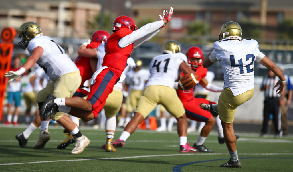 Dixie State's Orlando Wallace (6) blocks a punt, Dixie State University vs. Fort Lewis University, St. George, Utah, Nov. 12, 2016, | Photo by Robert Hoppie, ASPpix.com, St. George News