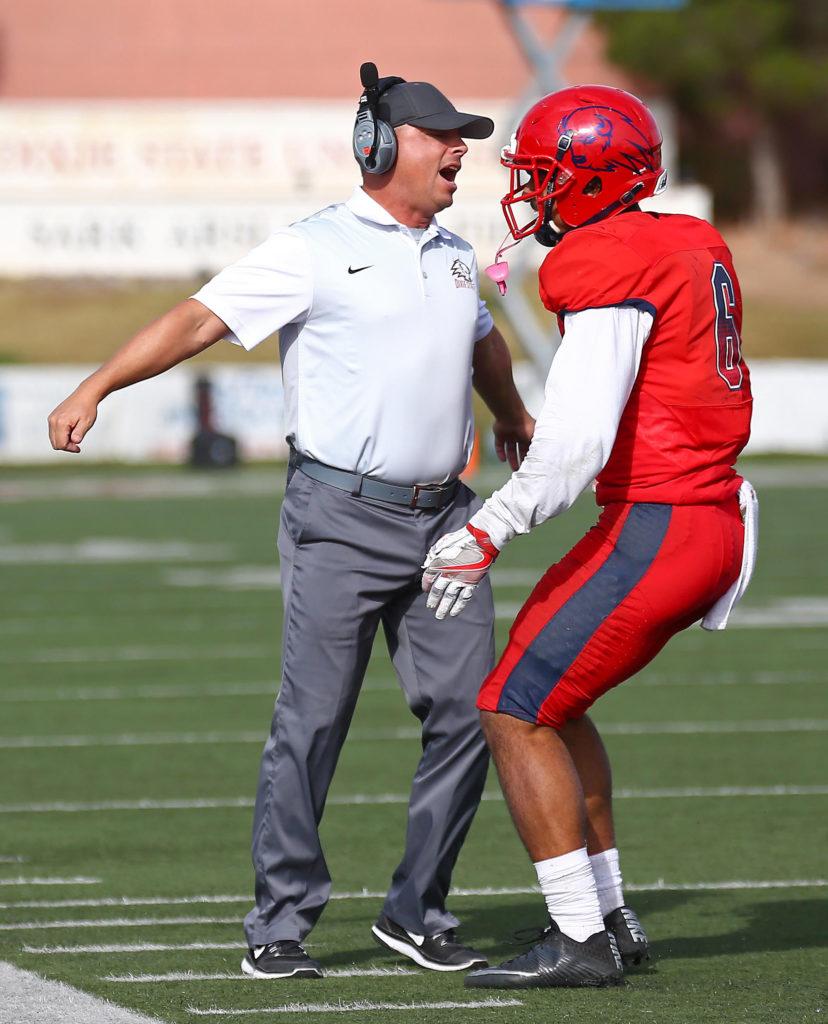 DSU coach Shay McClure chest bumps Dixie State University vs. Fort Lewis University, St. George, Utah, Nov. 12, 2016, | Photo by Robert Hoppie, ASPpix.com, St. George News