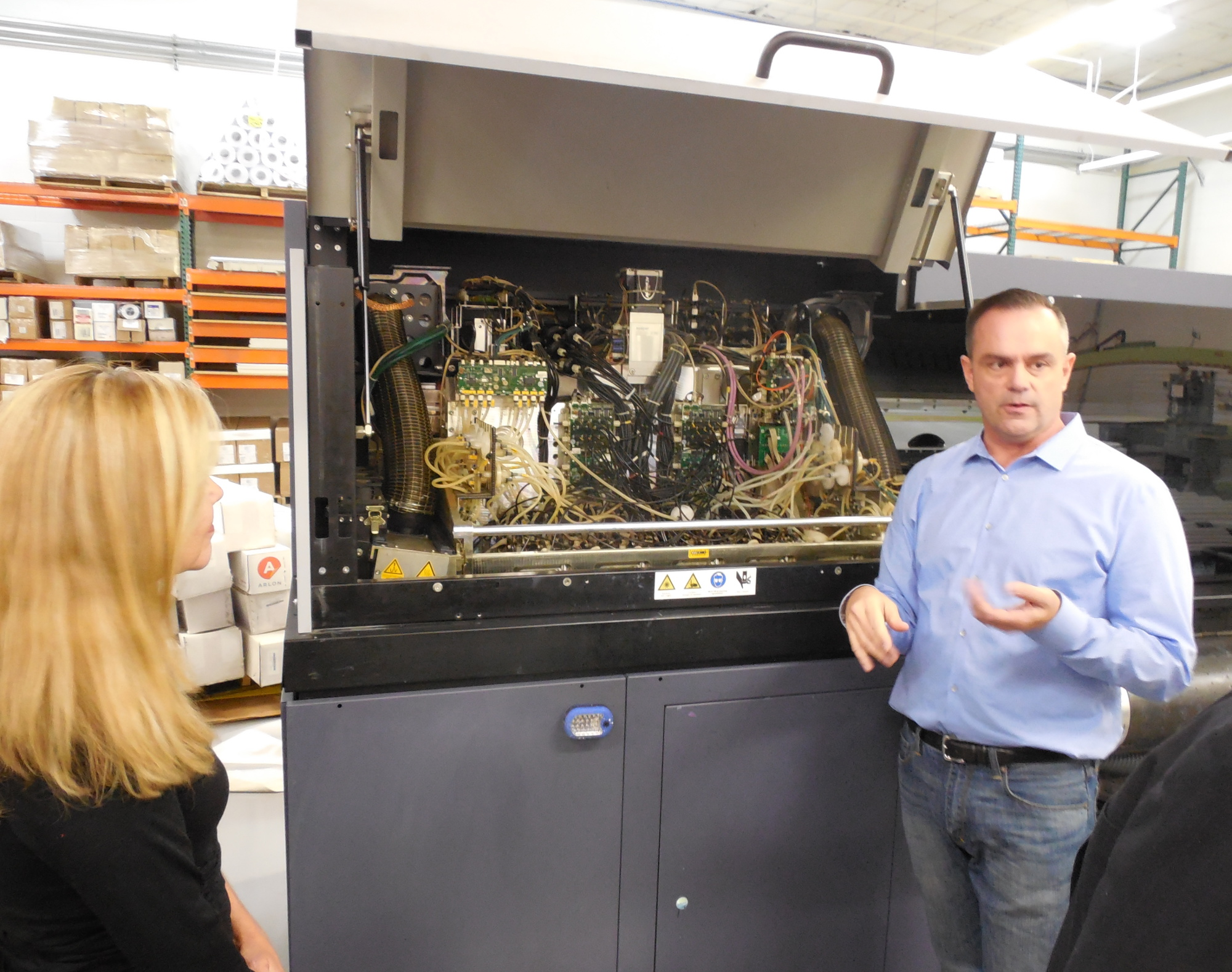 Josh Bevans shows off a high-tech printing press to Small Business Administration Regional Director Betsy Marky during a tour of Design to Print, St. George, Utah, Nov. 17, 2016 | Photo by Julie Applegate, St. George News