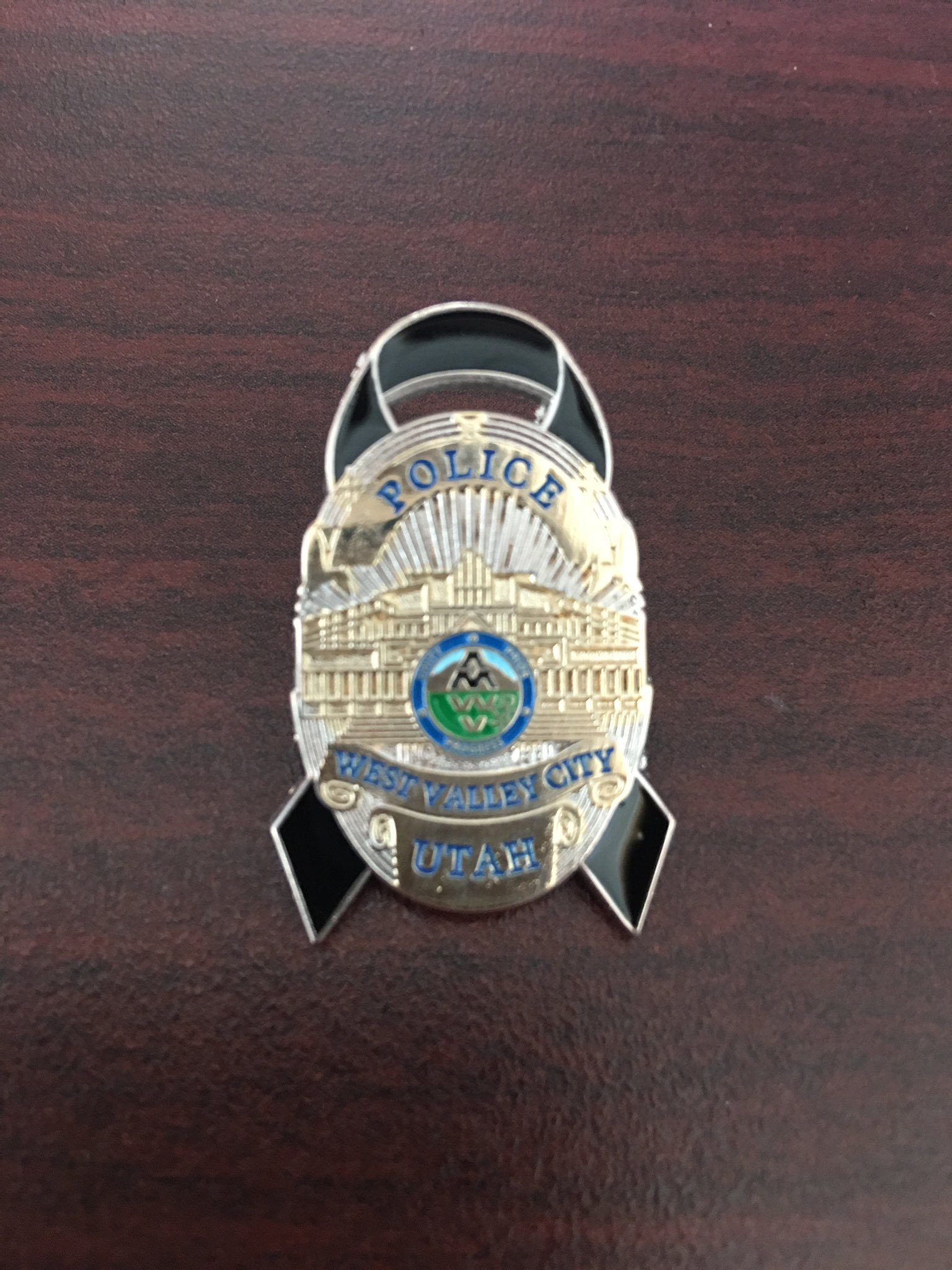 "West Valley City Police tweeted ""Our officers will shroud their badge in honor of Officer #CodyBrotherson. Non-sworn will wear this pin"" with this photo Sunday around 12:15 p.m., Nov. 6, 2016 
