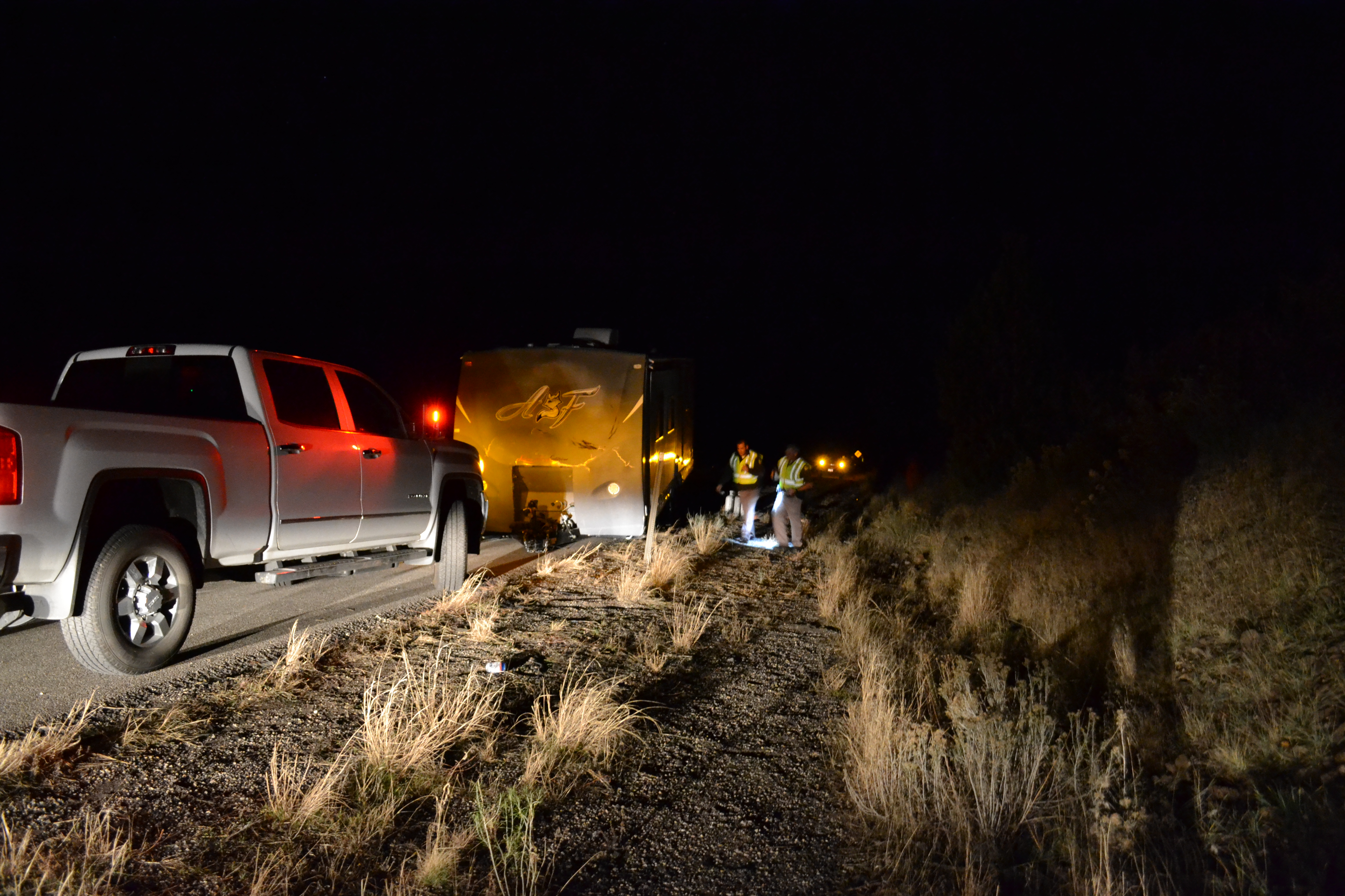 L-R: Utah Highway Patrol Troopers Joe Pastor and Mike Murphey examine the scene of a trailer rollover on Interstate 15, Washington County, Utah, Nov. 26, 2016 | Photo by Joseph Witham, St. George News